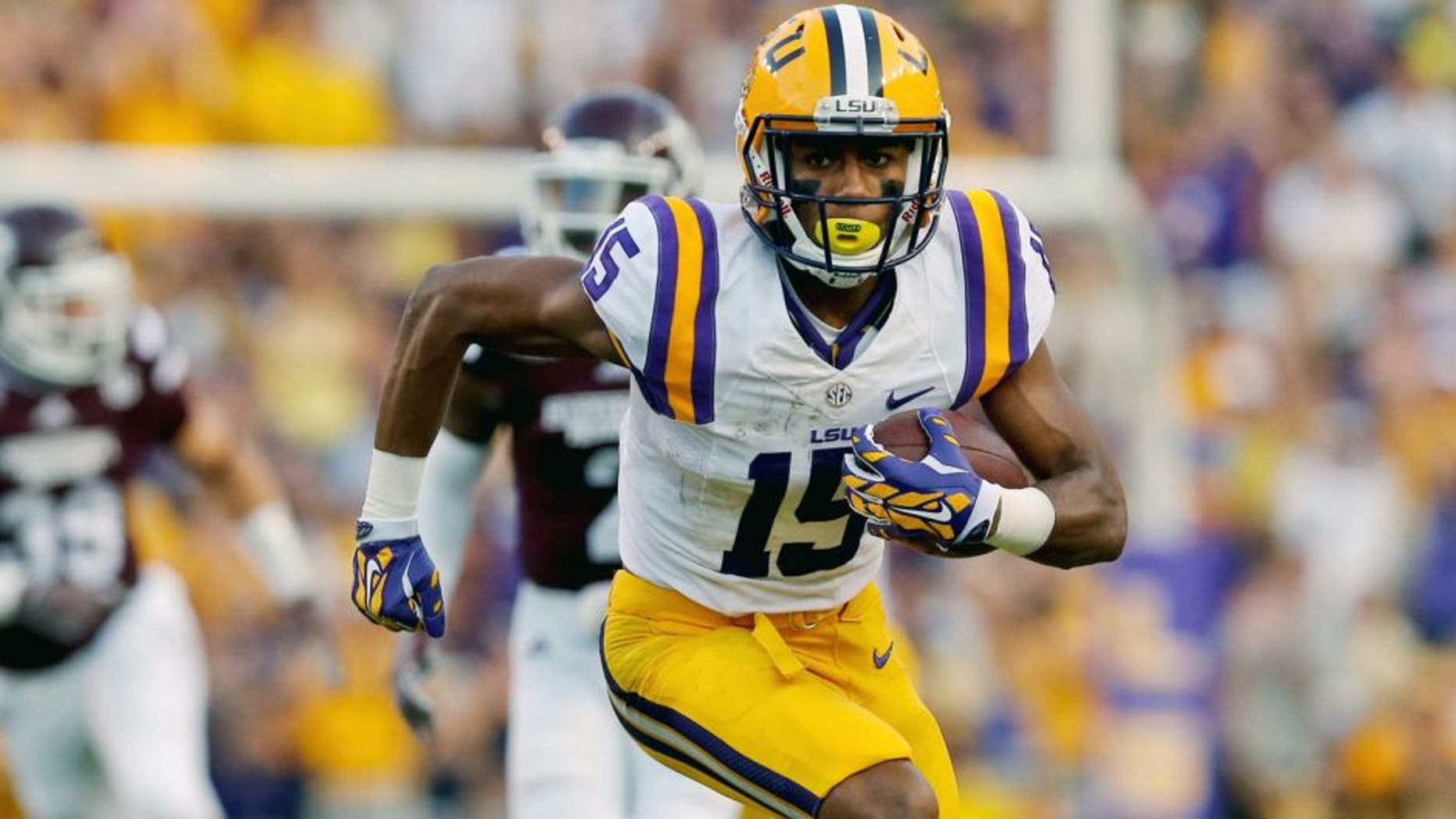 Sep 20, 2014; Baton Rouge, LA, USA; LSU Tigers wide receiver Malachi Dupre (15) runs after a catch against the Mississippi State Bulldogs during the first half of a game at Tiger Stadium. Mandatory Credit: Derick E. Hingle-USA TODAY Sports
