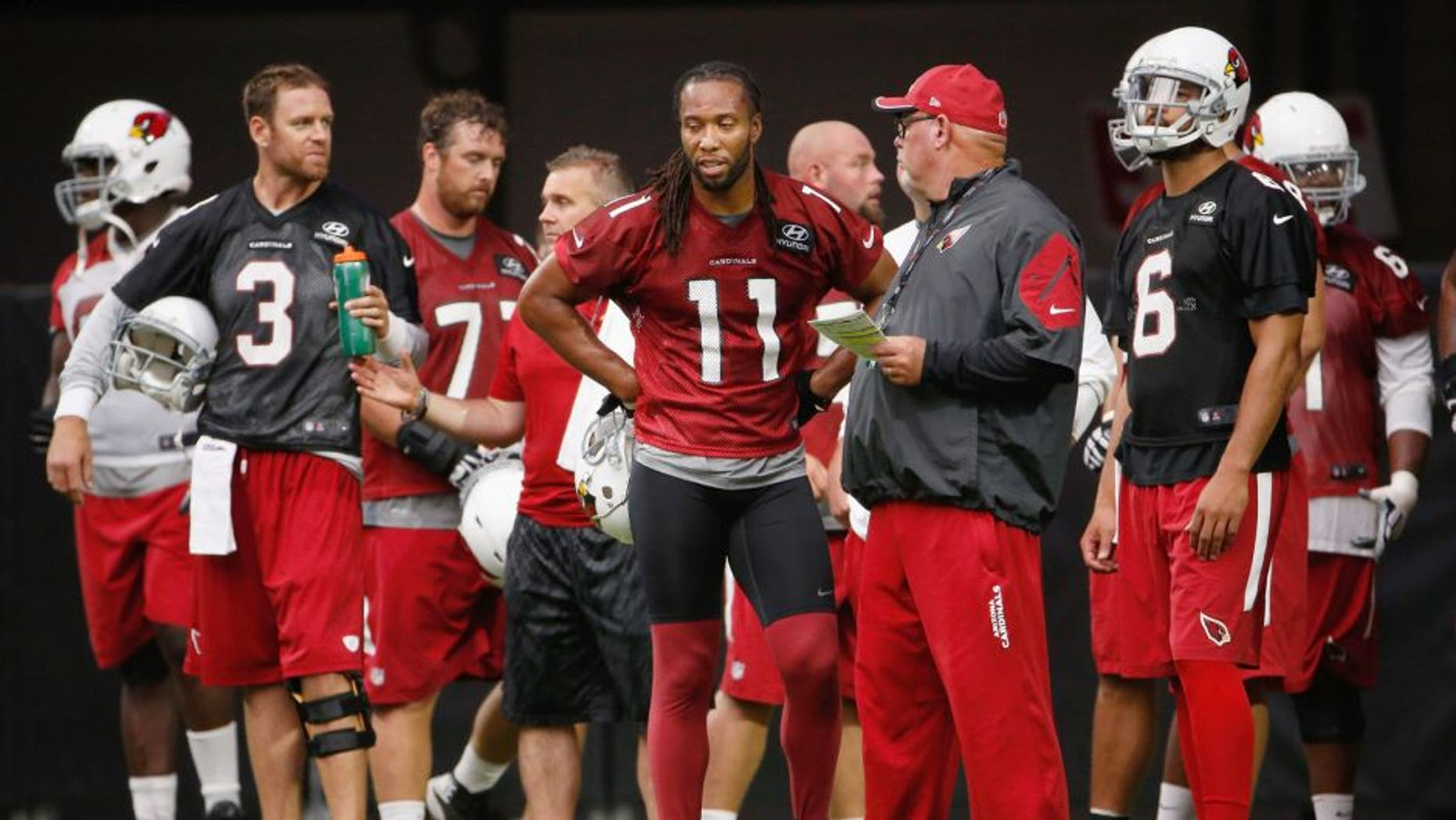 GLENDALE, AZ - AUGUST 02: (L-R) Carson Palmer #3, Larry Fitzgerald #11, Bruce Arians and Logan Thomas #6 of the Arizona Cardinals stand on the field during the team training camp at University of Phoenix Stadium on August 2, 2015 in Glendale, Arizona. (Photo by Christian Petersen/Getty Images)