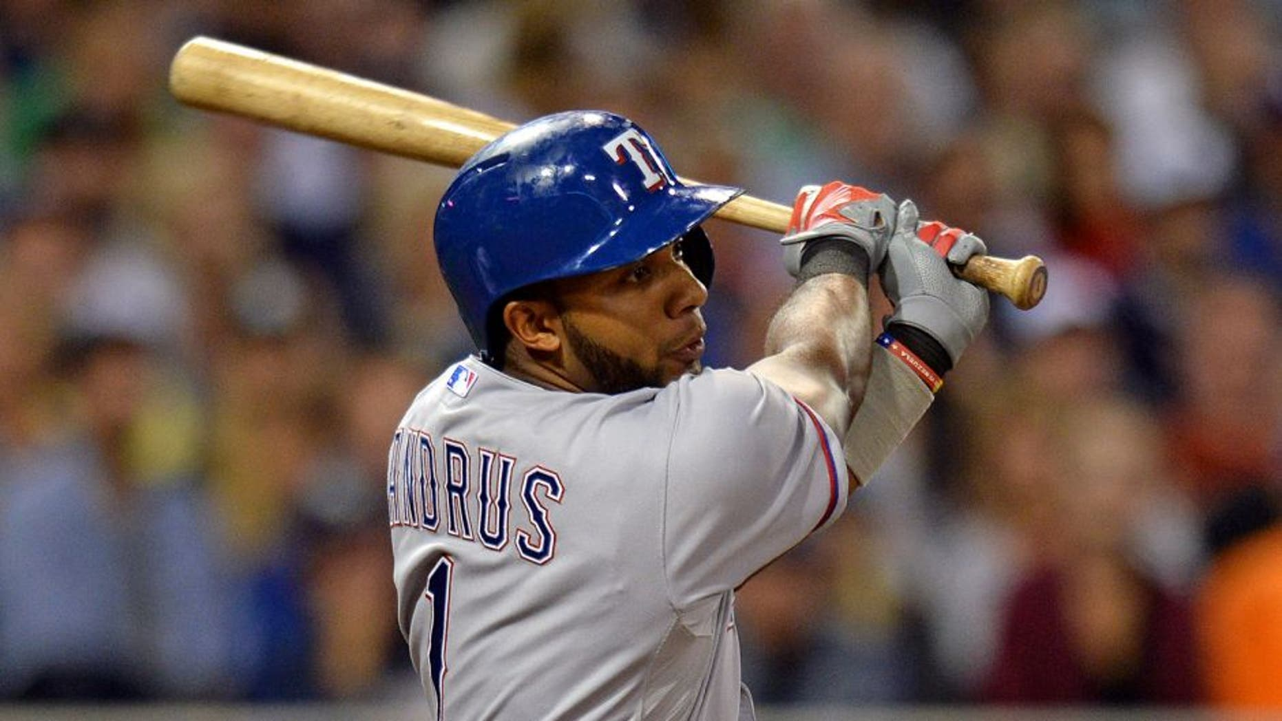 Sep 1, 2015; San Diego, CA, USA; Texas Rangers shortstop Elvis Andrus (1) hits an RBI single during the seventh inning against the San Diego Padres at Petco Park. Mandatory Credit: Jake Roth-USA TODAY Sports