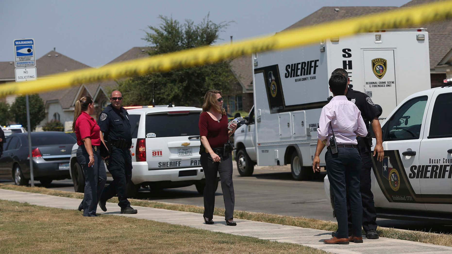 Aug. 28, 2015: The Bexar County Sheriff's Department investigates the scene where deputies shot a man as they responded to a domestic disturbance call in Northwest Bexar County, Texas, near San Antonio.