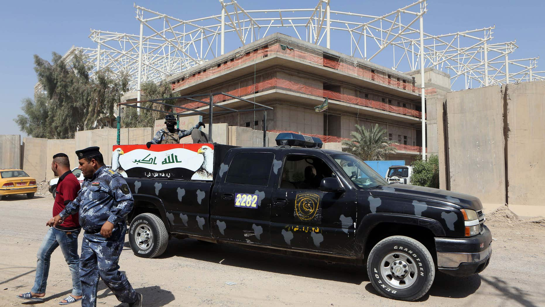 Sept. 2, 2015: Iraqi security forces guard the entrance to a sports complex being built by a Turkish construction company, in the Shiite district of Sadr City, Baghdad, Iraq.