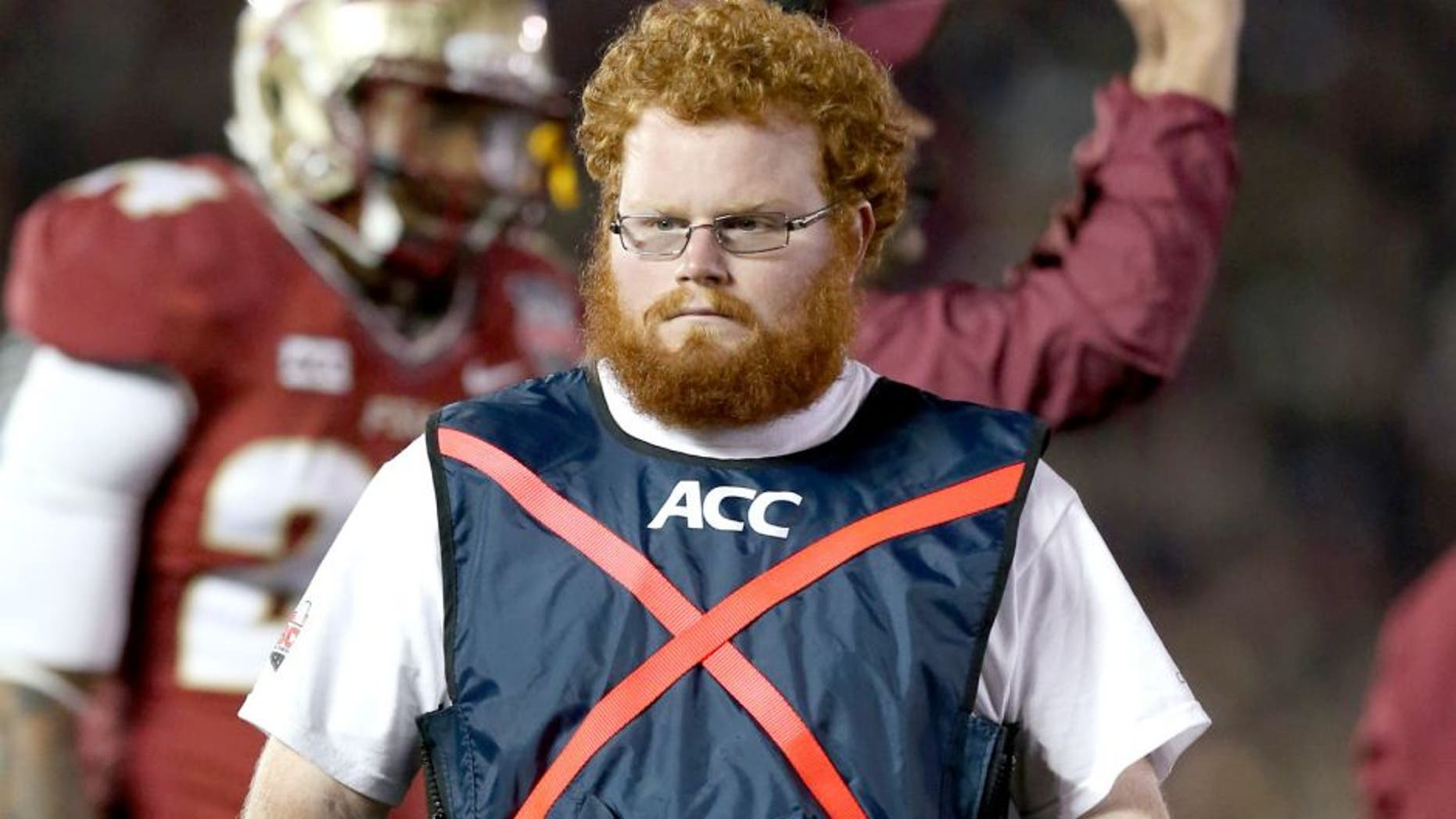 Jan 6, 2014; Pasadena, CA, USA; Florida State Seminoles ball boy assistant equipment manager Frankie Grizzle-Malgrat also know as Red Lightning on the sidelines during the game against the Auburn Tigers in the 2014 BCS National Championship game at the Rose Bowl. Mandatory Credit: Matthew Emmons-USA TODAY Sports