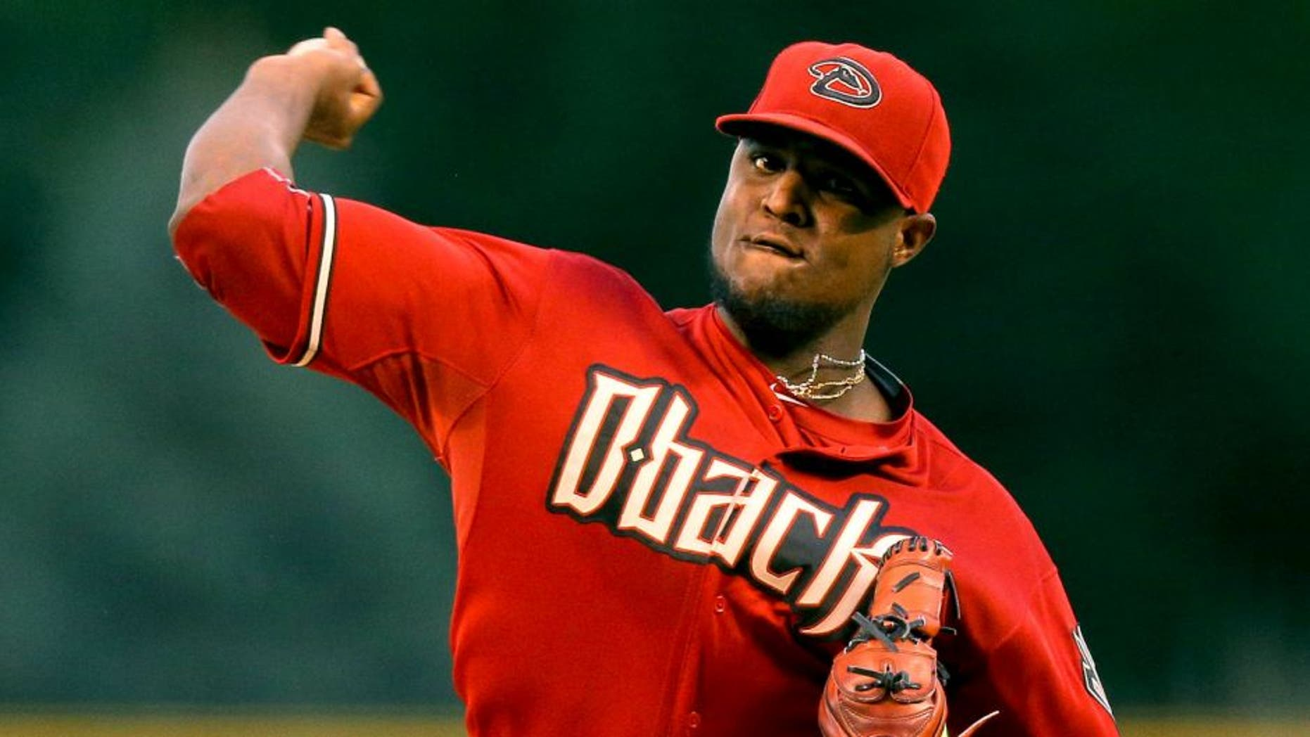 DENVER, CO - SEPTEMBER 1: Starting pitcher Rubby De La Rosa #12 of the Arizona Diamondbacks delivers to home plate during the first inning against the Colorado Rockies at Coors Field on September 1, 2015 in Denver, Colorado. (Photo by Justin Edmonds/Getty Images)