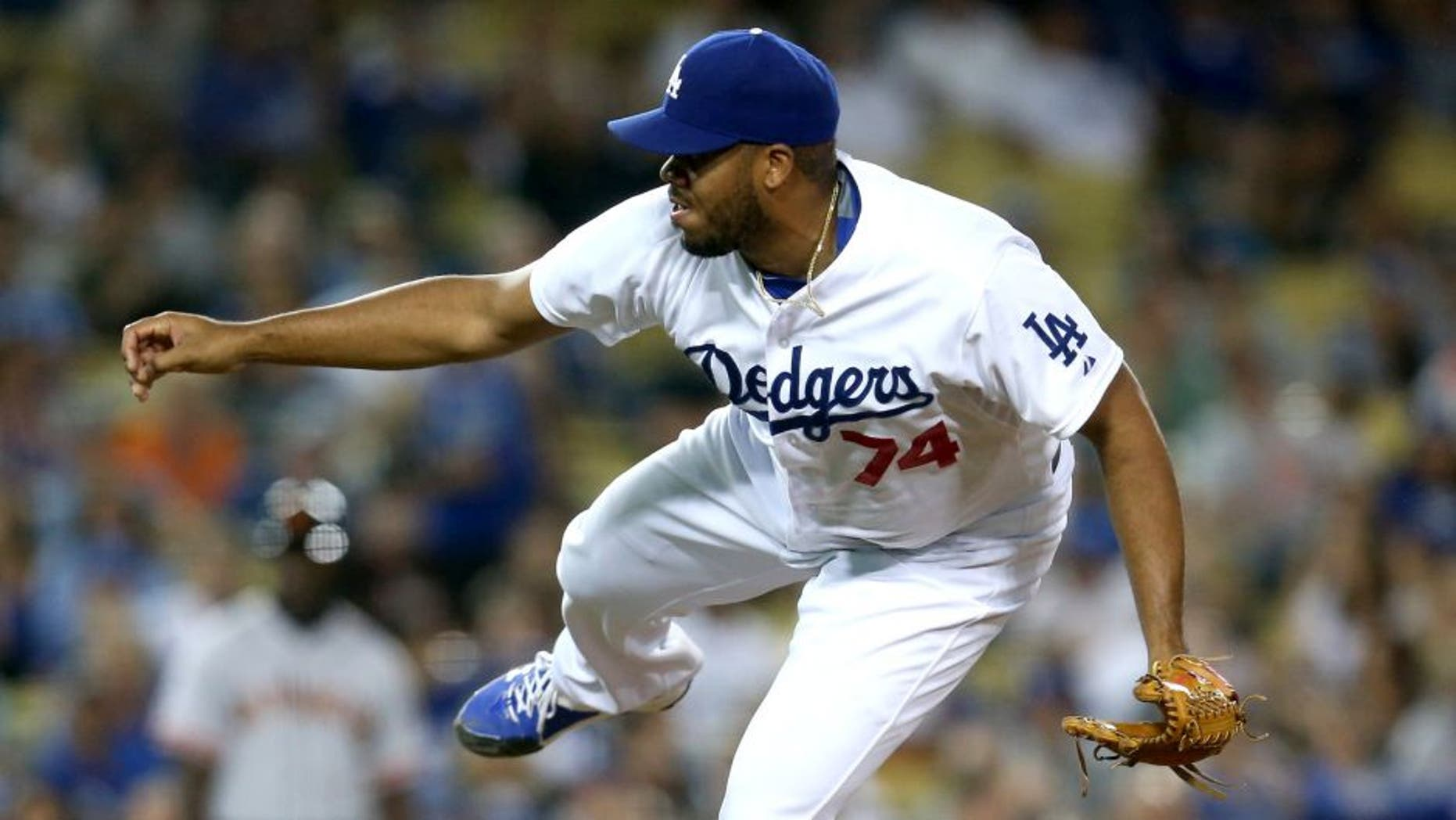 LOS ANGELES, CA - SEPTEMBER 01: Closer Kenley Jansen #74 of the Los Angeles Dodgers throws a pitch in the ninth inning on his way to getting the save against the San Francisco Giants at Dodger Stadium on September 1, 2015 in Los Angeles, California (Photo by Stephen Dunn/Getty Images)