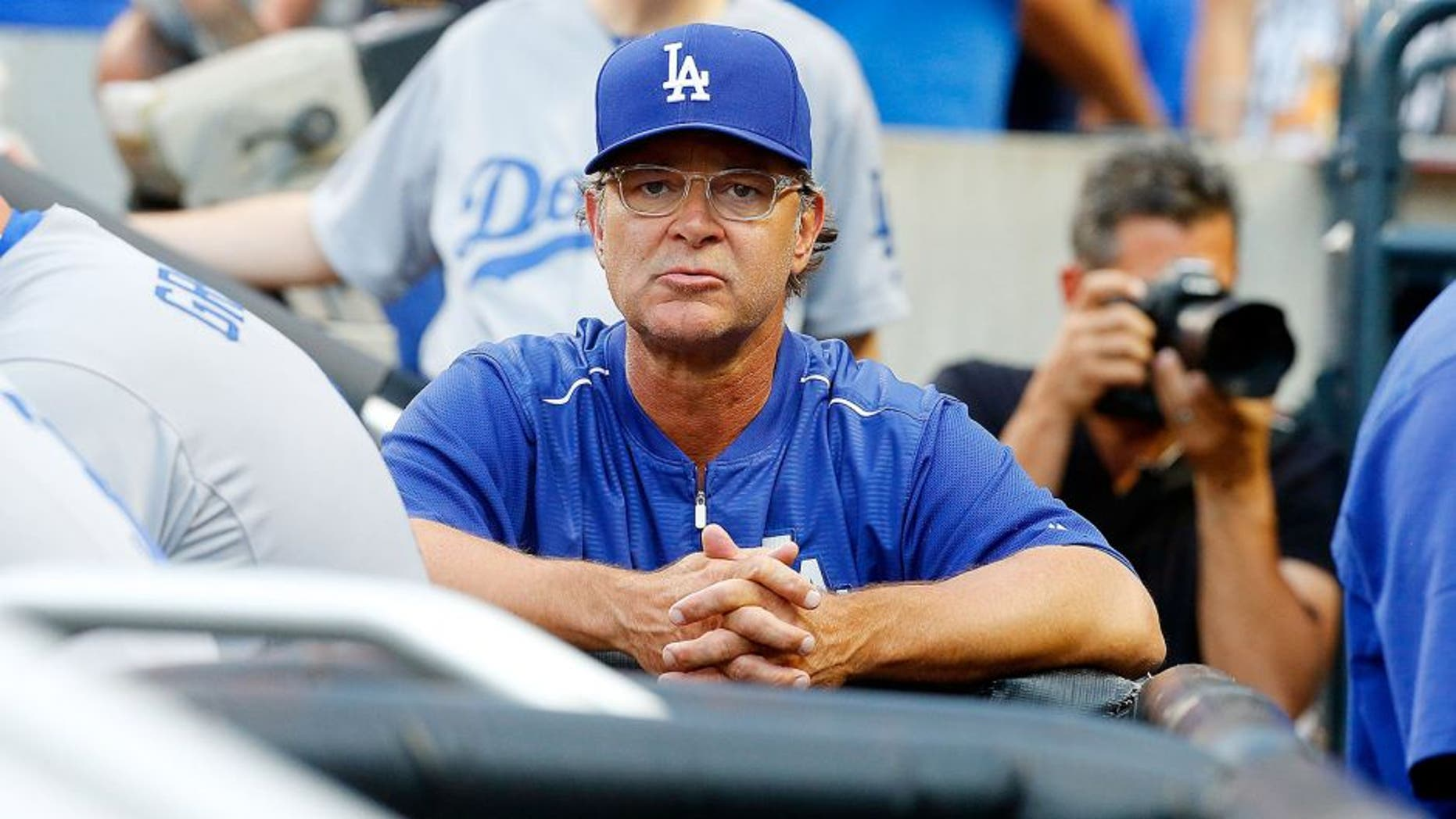 NEW YORK, NY - JULY 24: (NEW YORK DAILIES OUT) Manager Don Mattingly #8 of the Los Angeles Dodgers looks on against the New York Mets at Citi Field on July 24, 2015 in the Flushing neighborhood of the Queens borough of New York City. The Dodgers defeated the Mets 7-2. (Photo by Jim McIsaac/Getty Images)