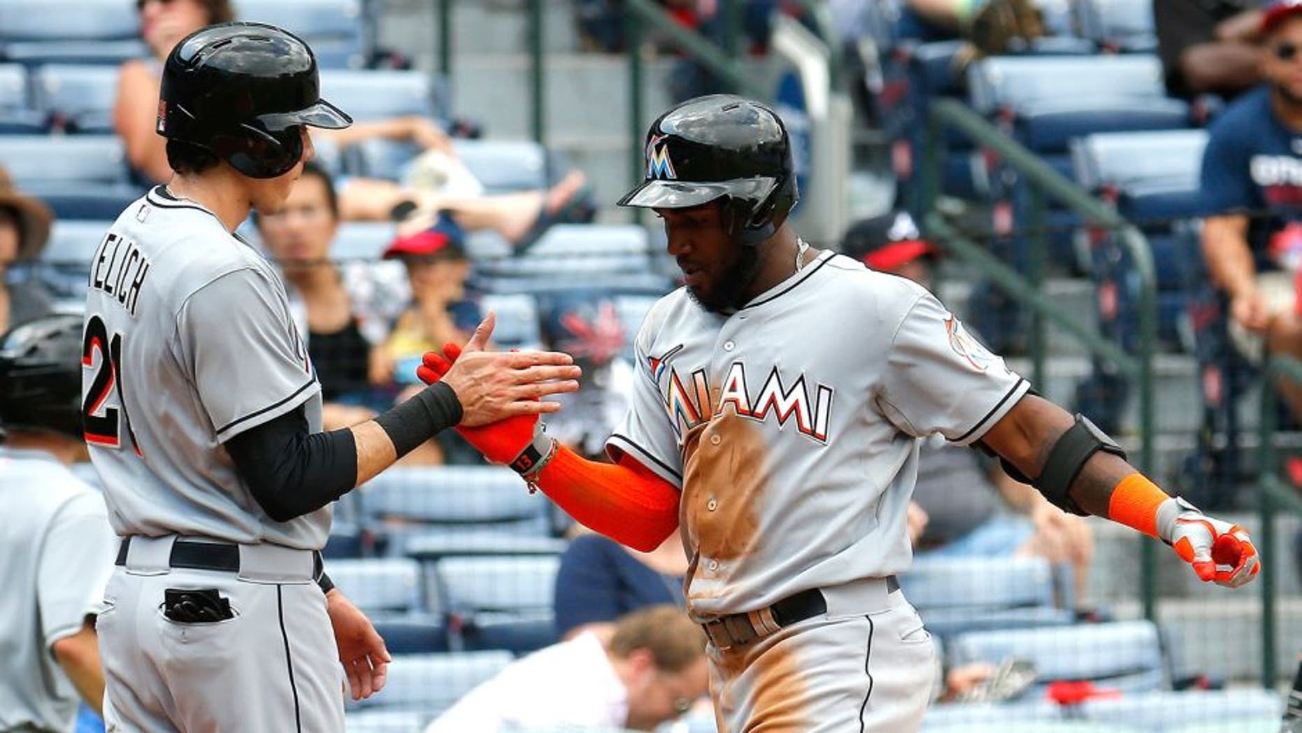 ATLANTA, GA - SEPTEMBER 02: Marcell Ozuna #13 of the Miami Marlins celebrates with Christian Yelich #21 after hitting a two-run homer in the fifth inning against the Atlanta Braves at Turner Field on September 2, 2015 in Atlanta, Georgia. (Photo by Kevin C. Cox/Getty Images)