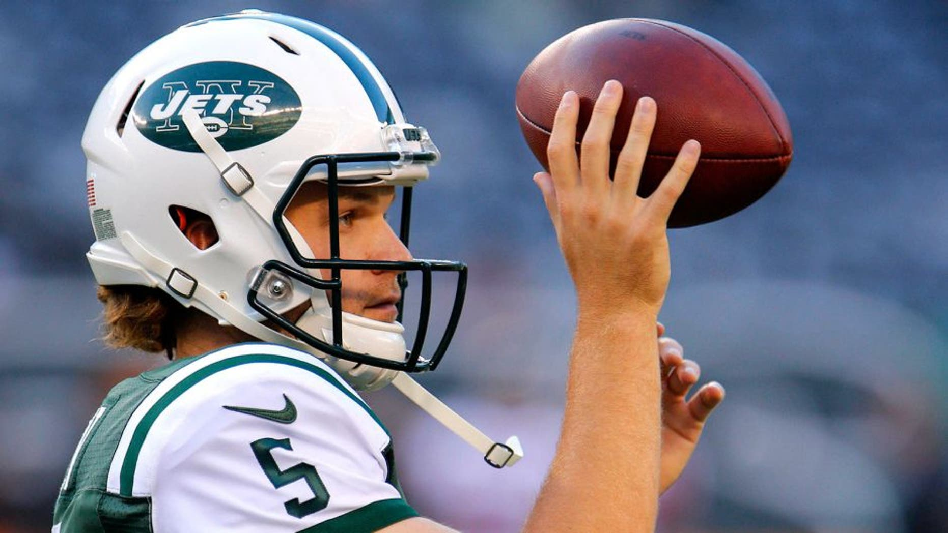 Aug 21, 2015; East Rutherford, NJ, USA; New York Jets quarterback Matt Flynn (5) during warm up before game against the Atlanta Falcons at MetLife Stadium. Mandatory Credit: Noah K. Murray-USA TODAY Sports