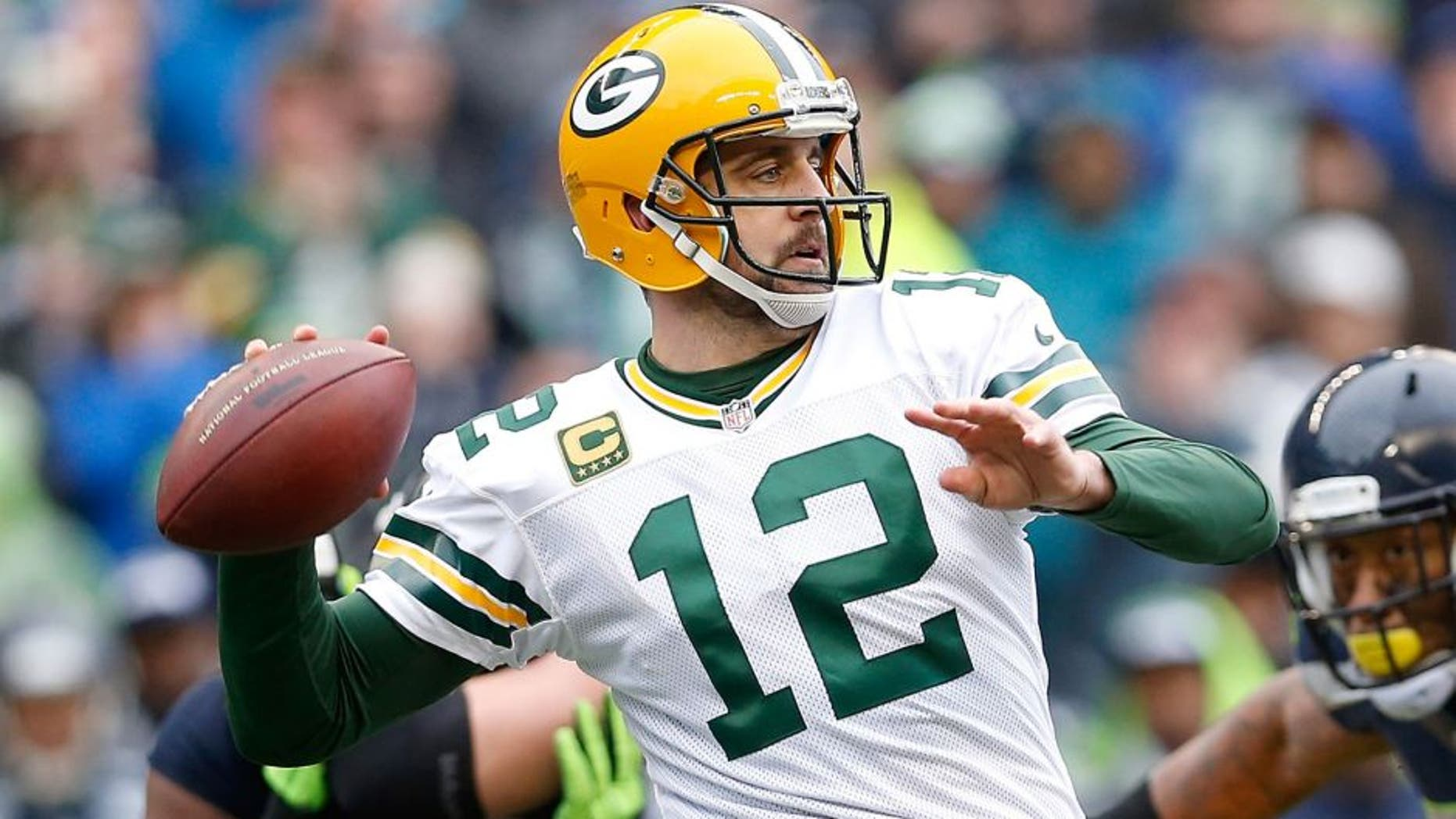 SEATTLE, WA - JANUARY 18: Quarterback Aaron Rodgers #12 of the Green Bay Packers in action during the 2015 NFC Championship game against the Seattle Seahawks at CenturyLink Field on January 18, 2015 in Seattle, Washington. The Seahawks defeated the Packers 28-22 in overtime. (Photo by Christian Petersen/Getty Images)