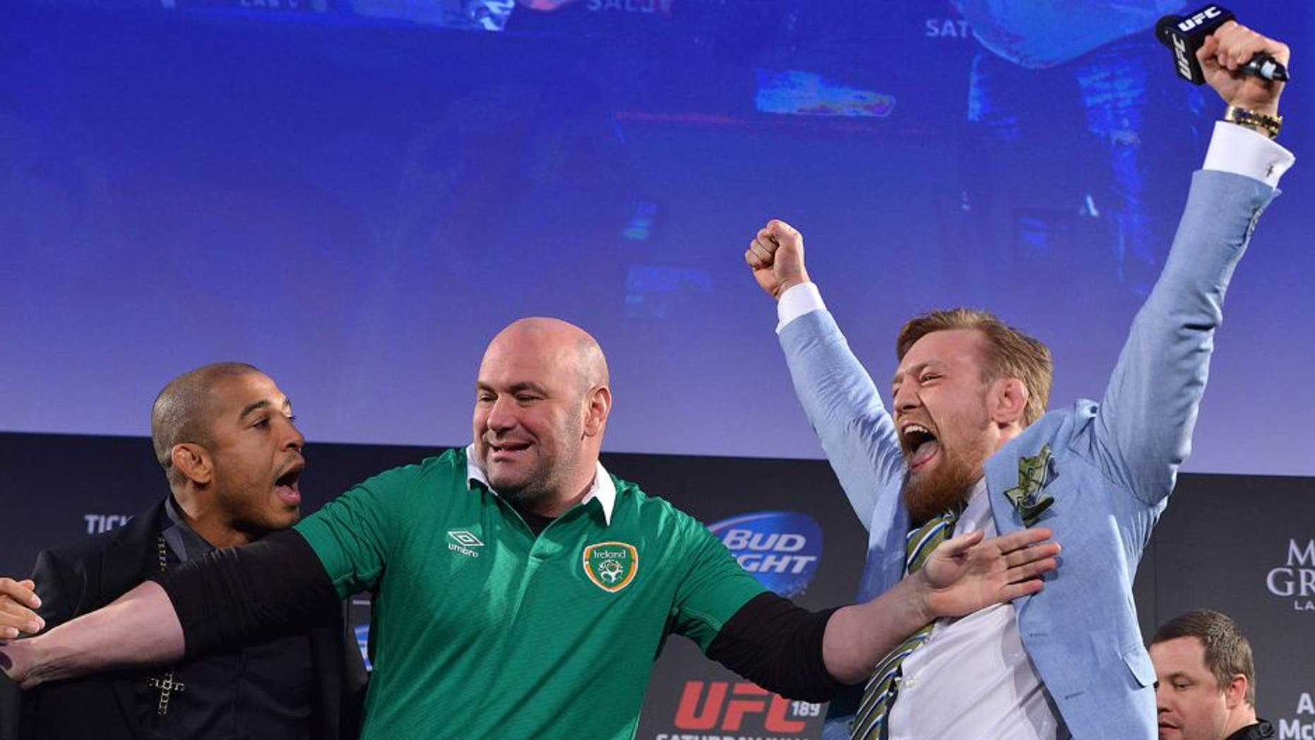 DUBLIN, IRELAND - MARCH 31: UFC featherweight title challenger Conor 'The Notorious' McGregor (R) steals UFC Featherweight Champion Jose Aldo's (L) belt as UFC President Dana White (C) separates the two during the UFC 189 World Championship Fan Event on March 31, 2015 in Dublin, Ireland. (Photo by Jeff Bottari/Zuffa LLC/Zuffa LLC via Getty Images)