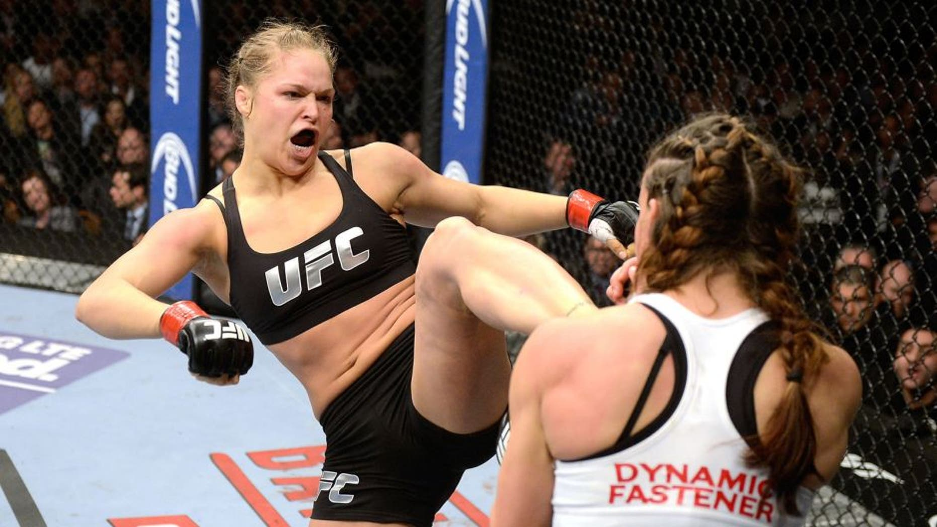 LAS VEGAS, NV - DECEMBER 28: (L-R) Ronda Rousey kicks Miesha Tate in their UFC women's bantamweight championship bout during the UFC 168 event at the MGM Grand Garden Arena on December 28, 2013 in Las Vegas, Nevada. (Photo by Donald Miralle/Zuffa LLC/Zuffa LLC via Getty Images)