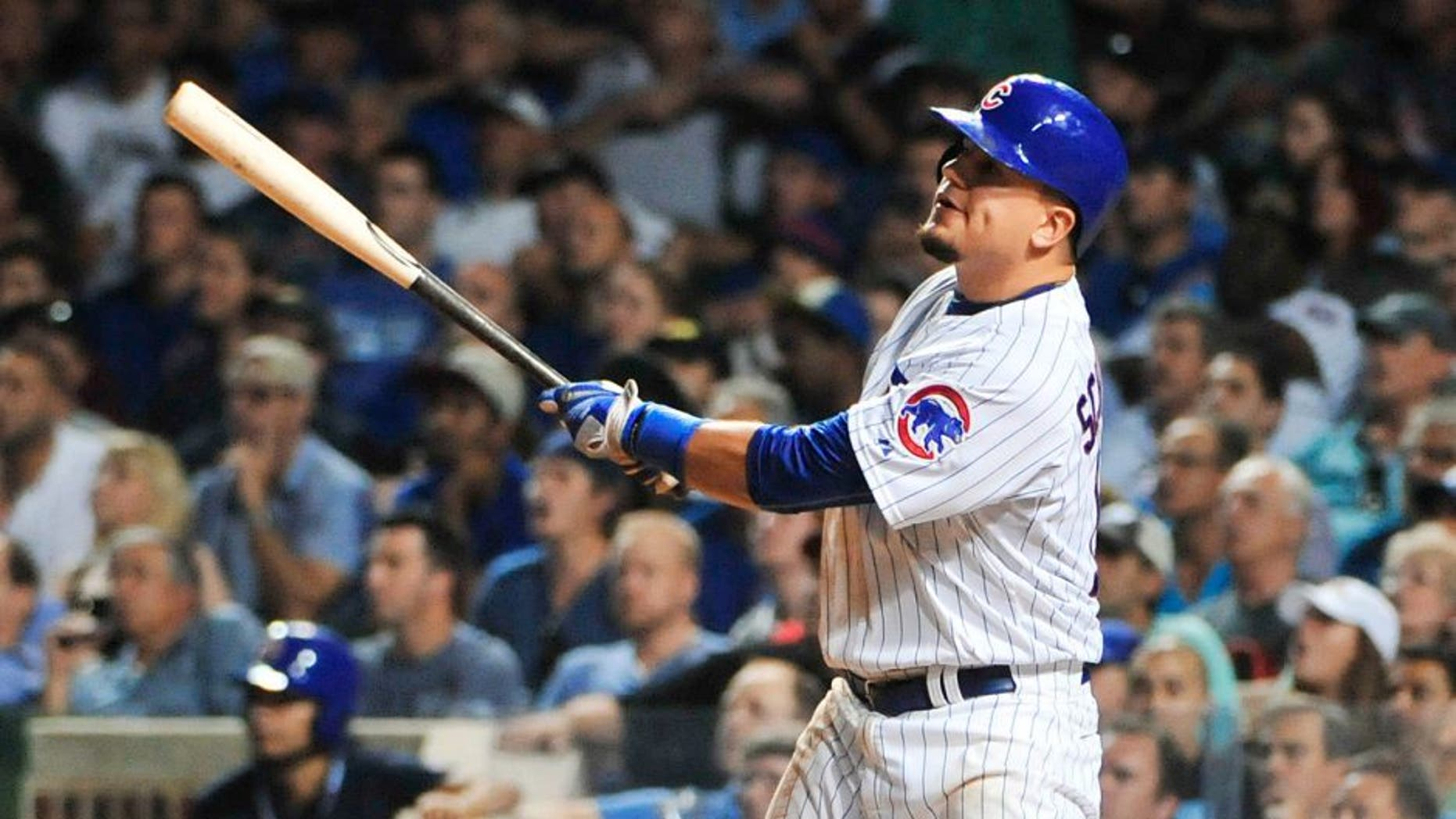 CHICAGO, IL - SEPTEMBER 01: Kyle Schwarber #12 of the Chicago Cubs hits a two-run home run against the Cincinnati Reds during the seventh inning on September 1, 2015 at Wrigley Field in Chicago, Illinois. (Photo by David Banks/Getty Images)