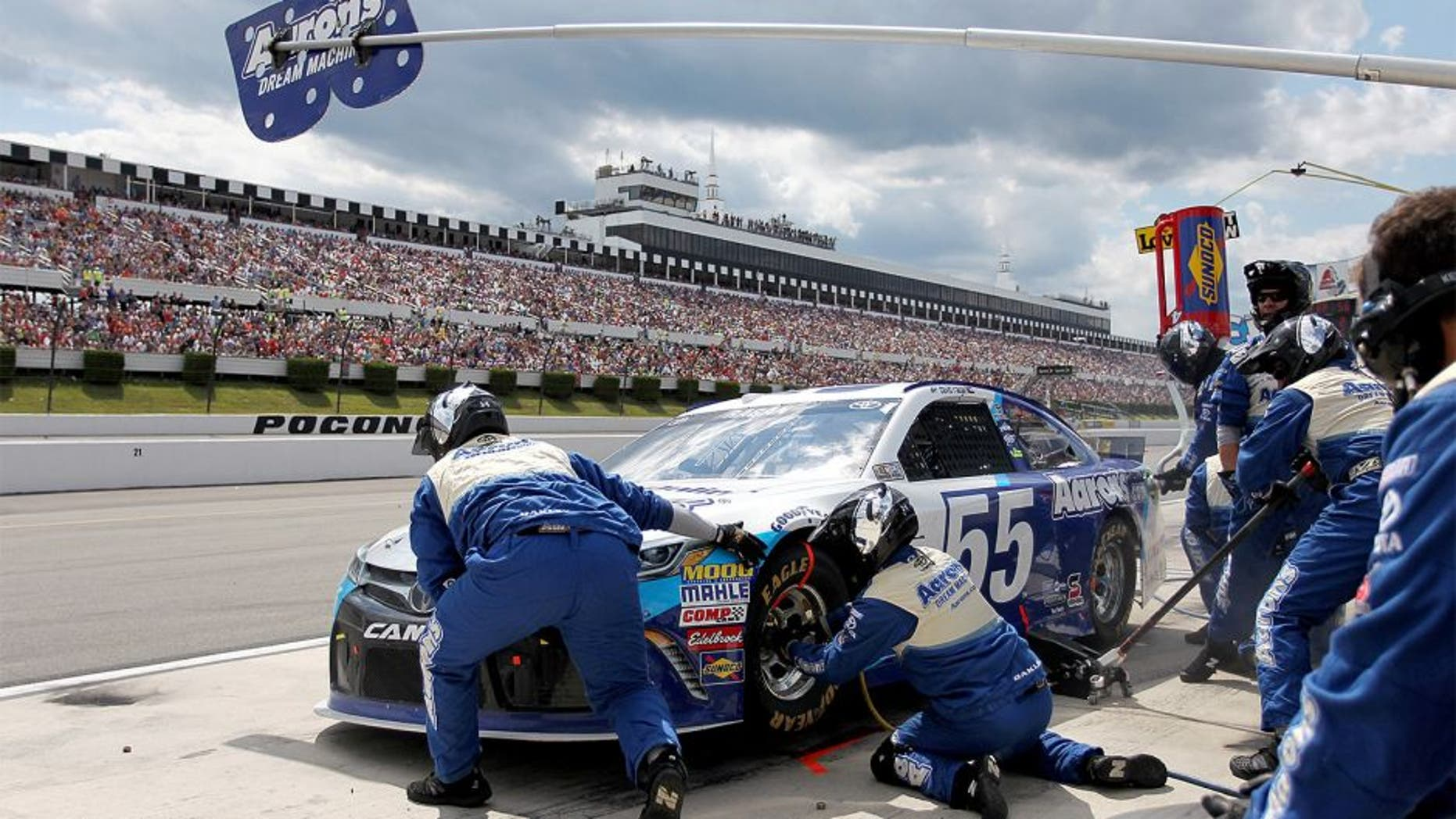 LONG POND, PA - AUGUST 02: David Ragan, driver of the #55 Aaron's Dream Machine Toyota, pits during the NASCAR Sprint Cup Series Windows 10 400 at Pocono Raceway on August 2, 2015 in Long Pond, Pennsylvania. (Photo by Tim Bradbury/Getty Images)