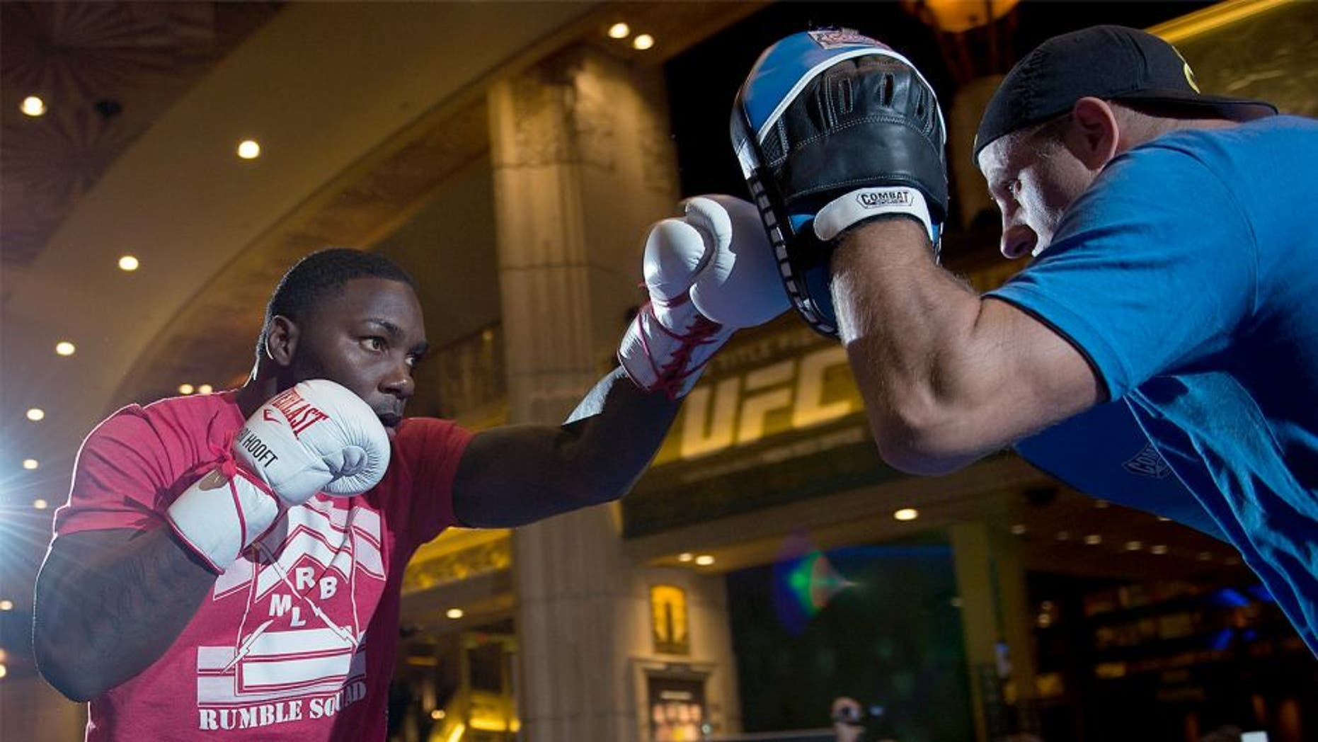 LAS VEGAS, NEVADA - MAY 20: Anthony Johnson (L) holds an open training session for fans and media at the MGM Grand Hotel/Casino on May 20, 2015 in Las Vegas Nevada. (Photo by Brandon Magnus/Zuffa LLC/Zuffa LLC via Getty Images)