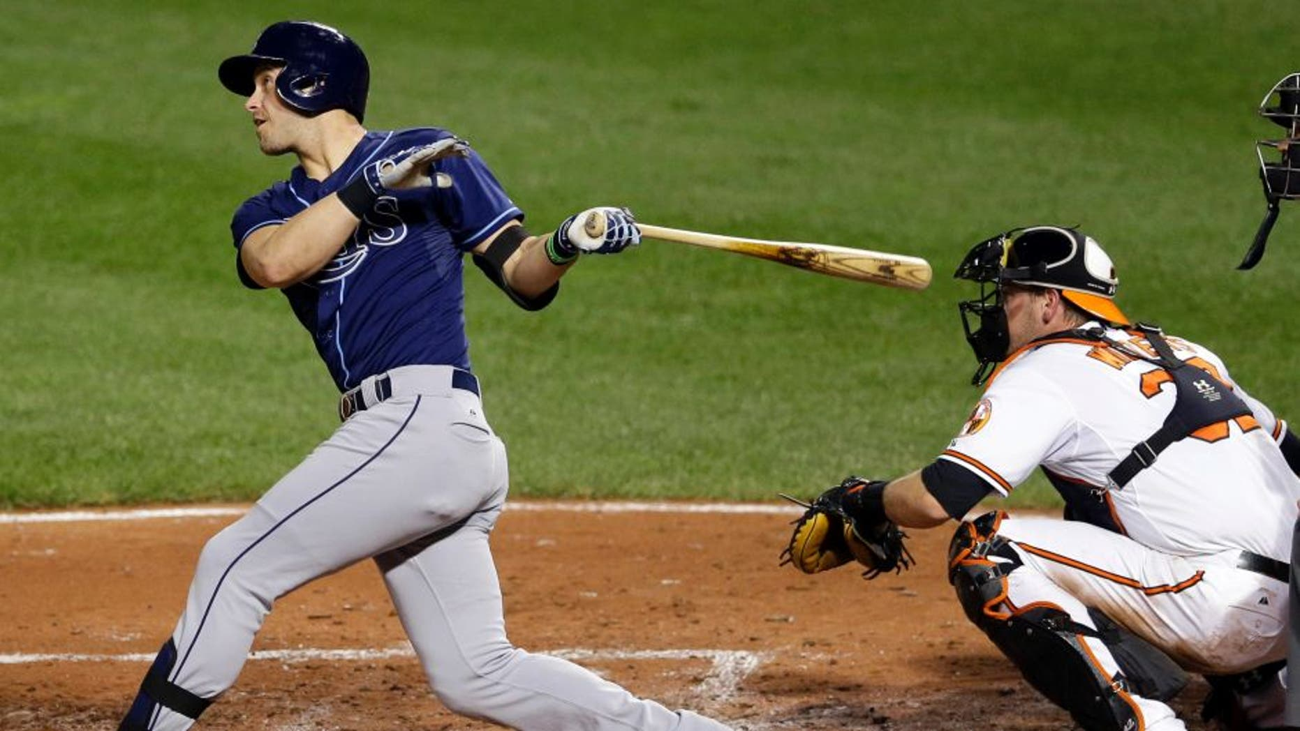 Tampa Bay Rays' Evan Longoria, left, watches his two-run home run in front of Baltimore Orioles catcher Matt Wieters and home plate umpire Cory Blaser in the third inning of a baseball game, Wednesday, Sept. 2, 2015, in Baltimore. (AP Photo/Patrick Semansky)