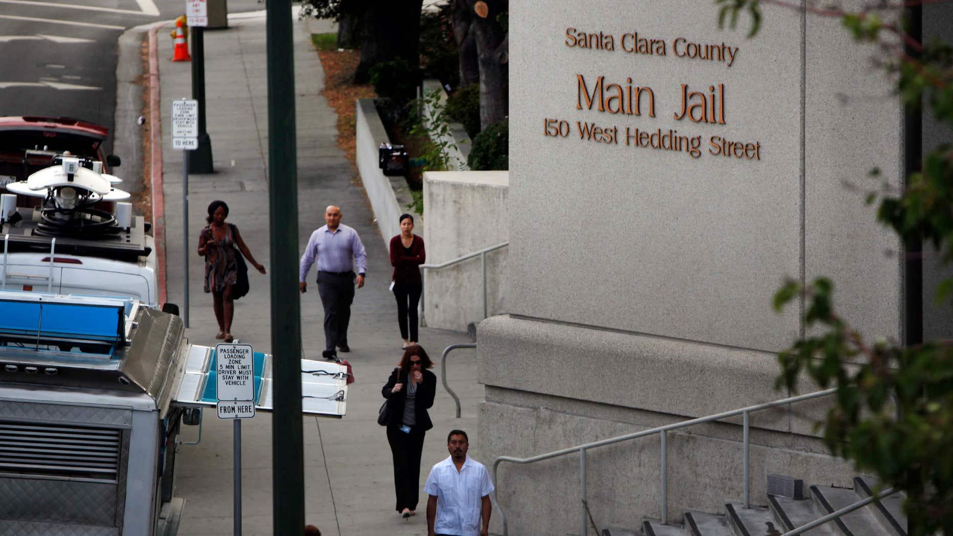 Sept. 2, 2015: Pedestrians walk past the Santa Clara County Jail in San Jose, Calif.