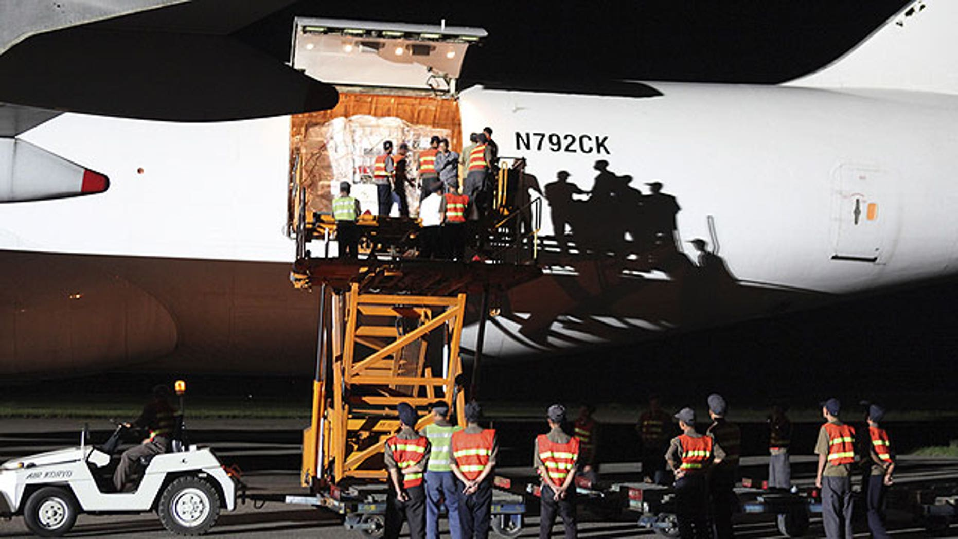 September 3: North Korean workers unload emergency aid sent from the United States from a plane upon arrival at Pyongyang airport, North Korea.