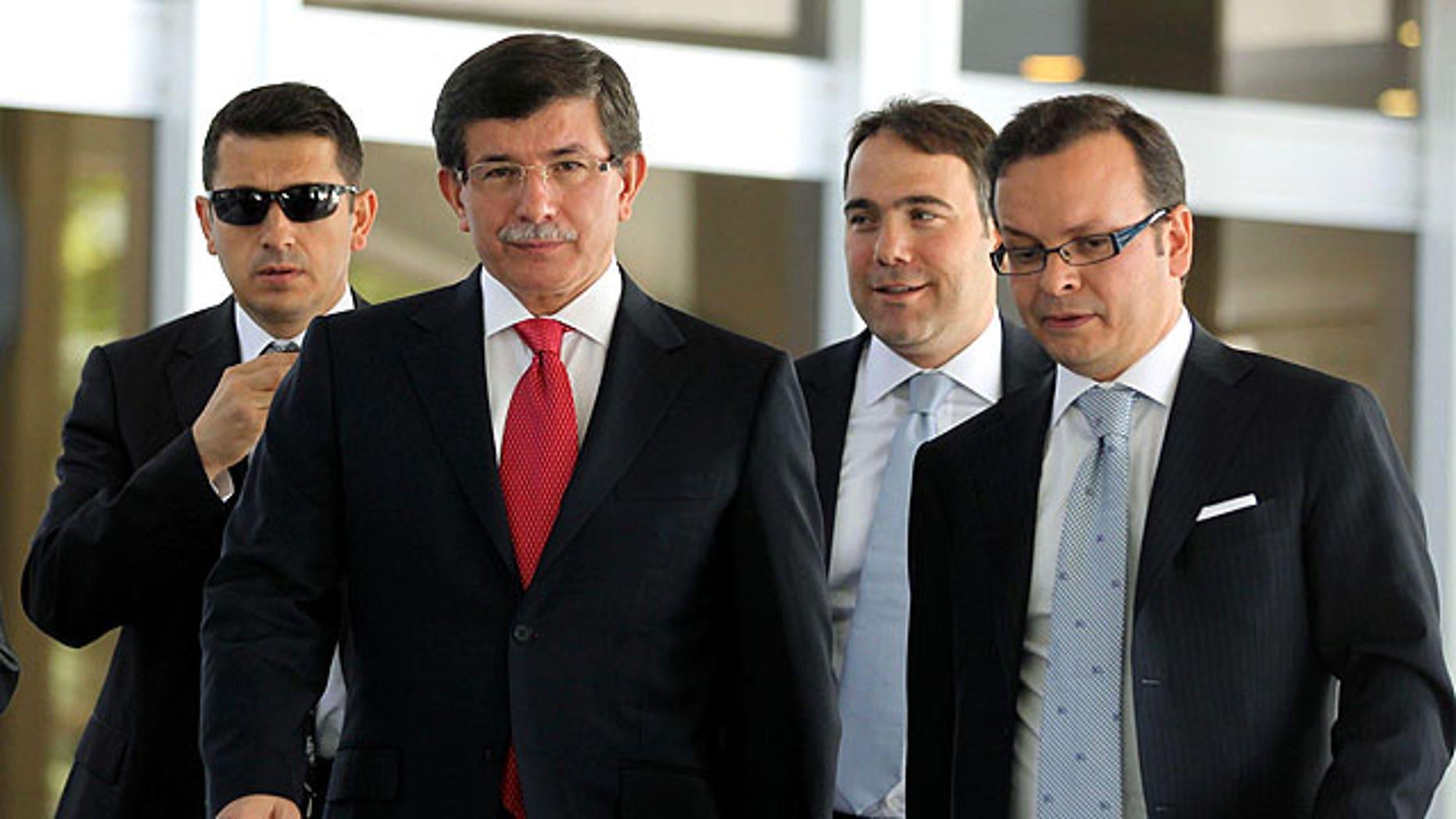 September 2: Turkish Foreign Minister Ahmet Davutoglu, centre left, leads advisors as he arrives to speak to the media in Ankara, Turkey.