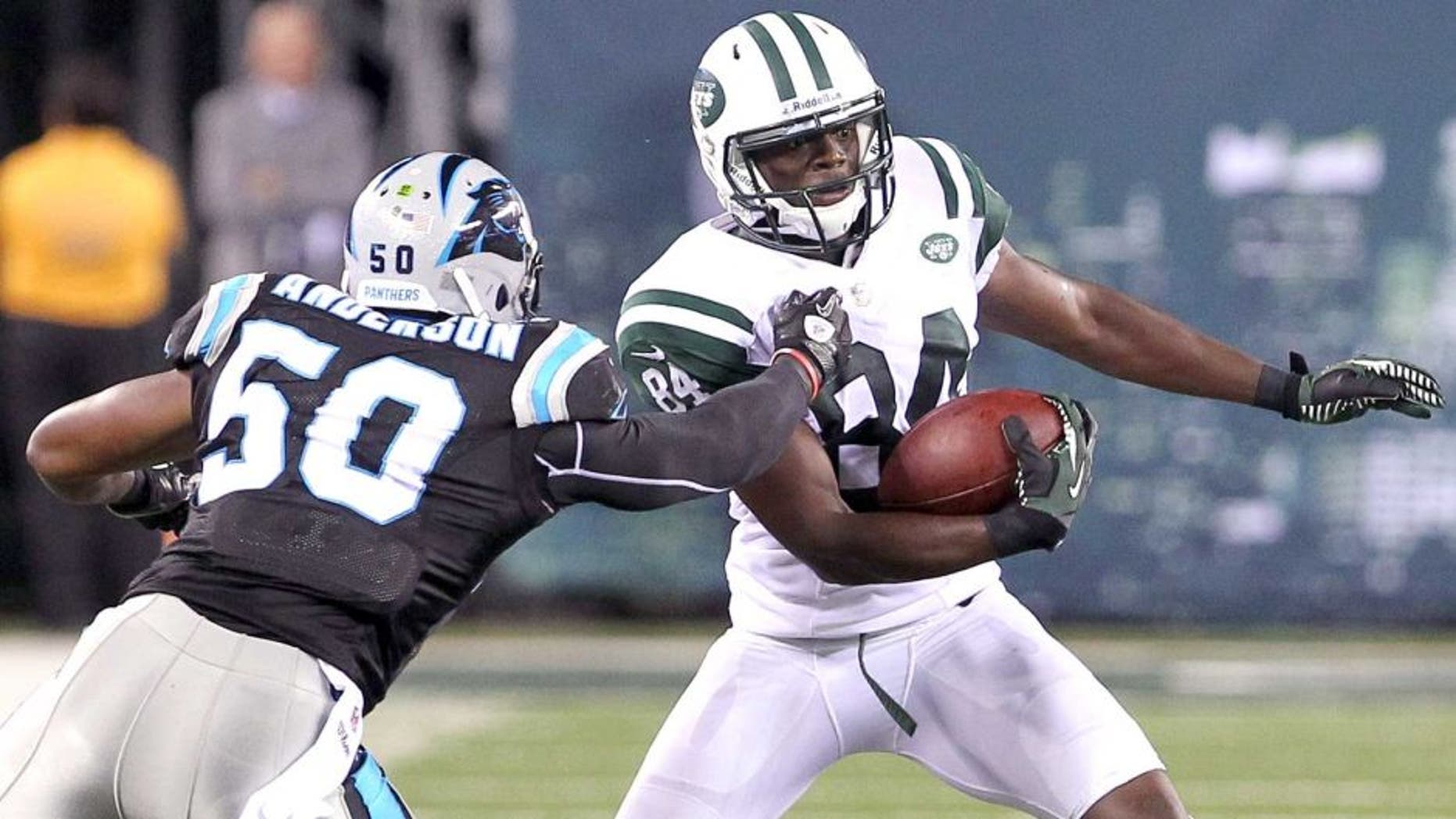 Aug 26, 2012; East Rutherford, NJ, USA; New York Jets wide receiver Stephen Hill (84) tries to avoid Carolina Panthers linebacker James Anderson (50) during the second half at MetLife Stadium. The Panthers defeated the Jets 17-12. Mandatory Credit: Ed Mulholland-USA TODAY Sports