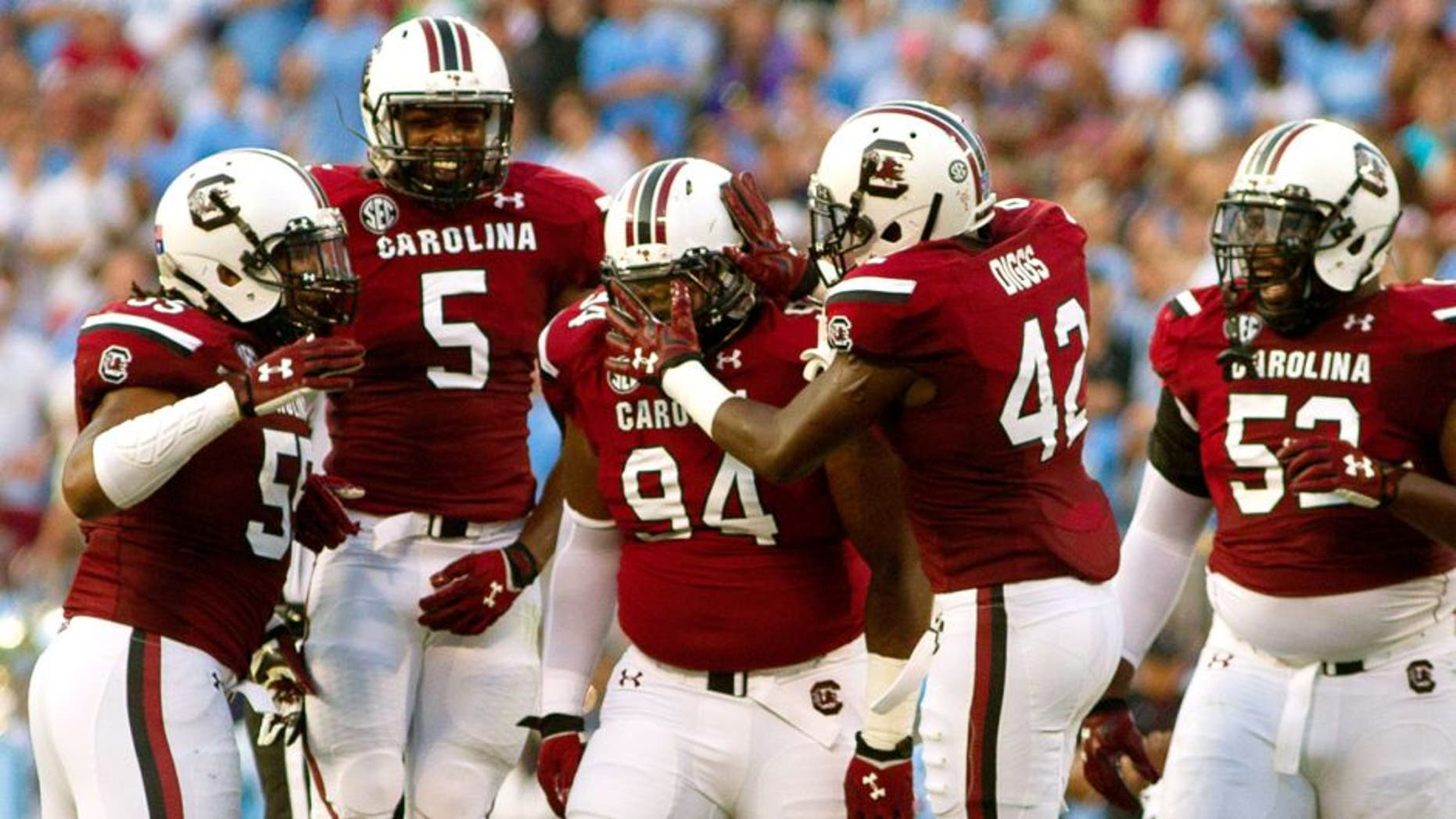 Sep 3, 2015; Charlotte, NC, USA; South Carolina Gamecocks defensive tackle Kelsey Griffin (94) celebrates with teammates during the second quarter against the North Carolina Tar Heels at Bank of America Stadium. Mandatory Credit: Joshua S. Kelly-USA TODAY Sports