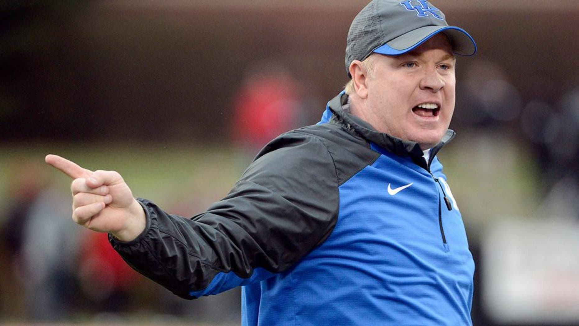 Nov 29, 2014; Louisville, KY, USA; Kentucky Wildcats head coach Mark Stoops reacts during the second half against the Louisville Cardinals at Papa John's Cardinal Stadium. Louisville defeated Kentucky 44-40. Mandatory Credit: Jamie Rhodes-USA TODAY Sports