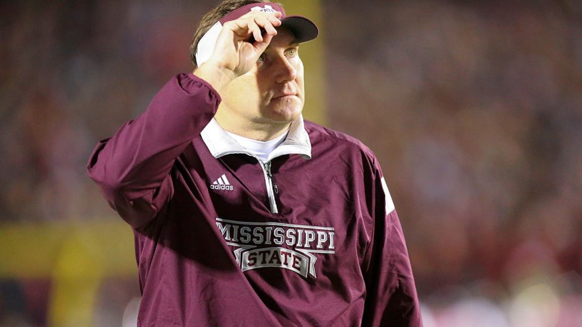 Nov 29, 2014; Oxford, MS, USA; Mississippi State Bulldogs head coach Dan Mullen looks on against the Mississippi Rebels at Vaught-Hemingway Stadium. The Rebels won 31-17. Mandatory Credit: Spruce Derden-USA TODAY Sports