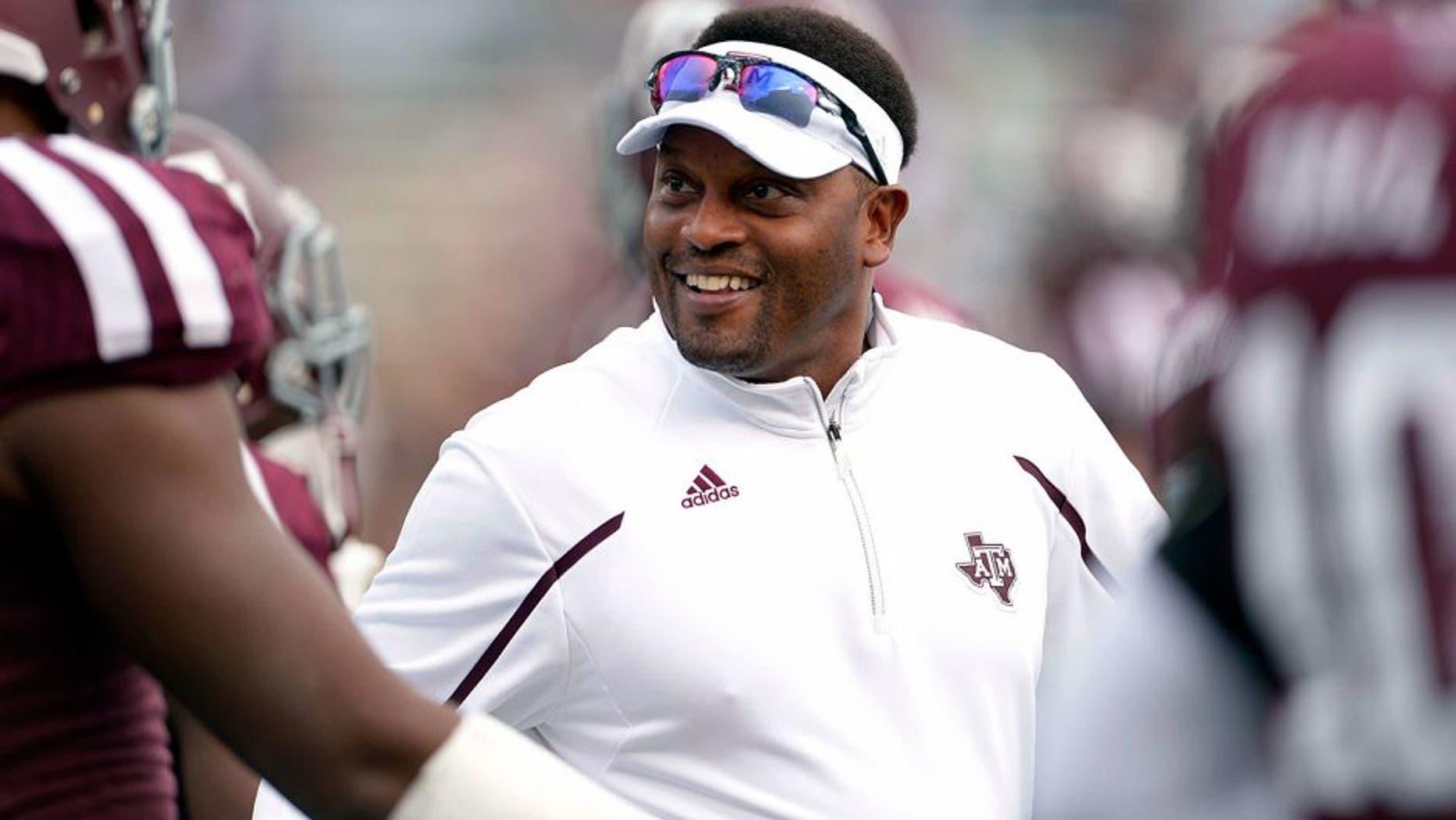 Nov 9, 2013; College Station, TX, USA; Texas A&M Aggies head coach Kevin Sumlin coaches before the game against the Mississippi State Bulldogs at Kyle Field. Mandatory Credit: Thomas Campbell-USA TODAY Sports