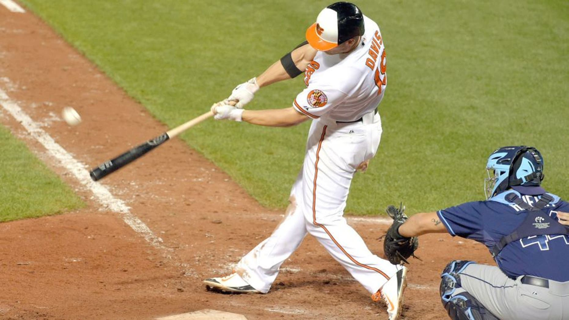 The Baltimore Orioles' Chris Davis crushes a solo home run against the Tampa Bay Rays at Oriole Park at Camden Yards in Baltimore on Wednesday, Sept. 2, 2015. The Orioles won, 7-6, in 11 innings on Davis' home run. (Karl Merton Ferron/Baltimore Sun/TNS via Getty Images)