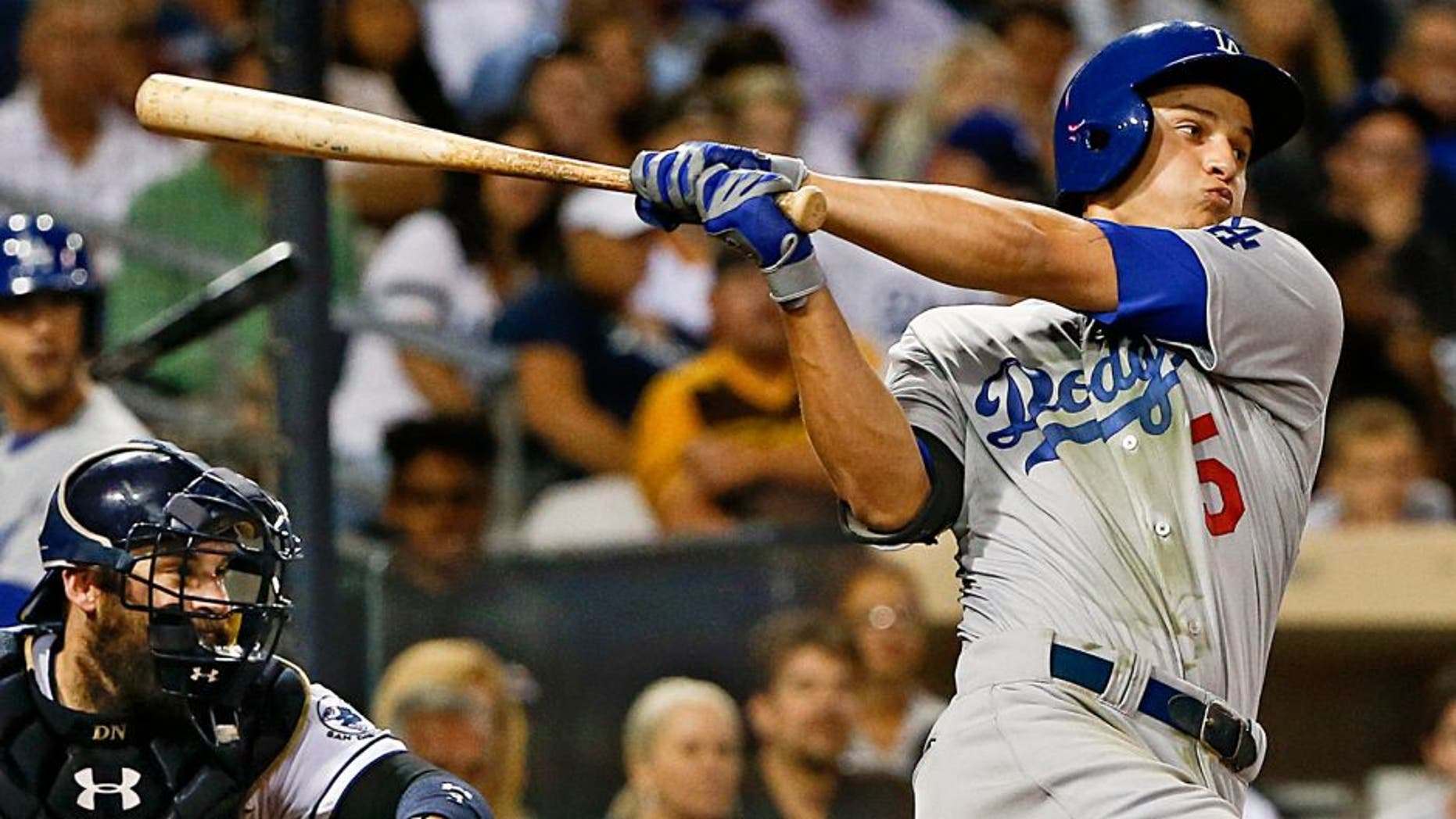 Los Angeles Dodgers' Corey Seager follows through with his second hit in his major league debut, during the sixth inning of a baseball game against the San Diego Padres on Thursday, Sept. 3, 2015, in San Diego. (AP Photo/Lenny Ignelzi)