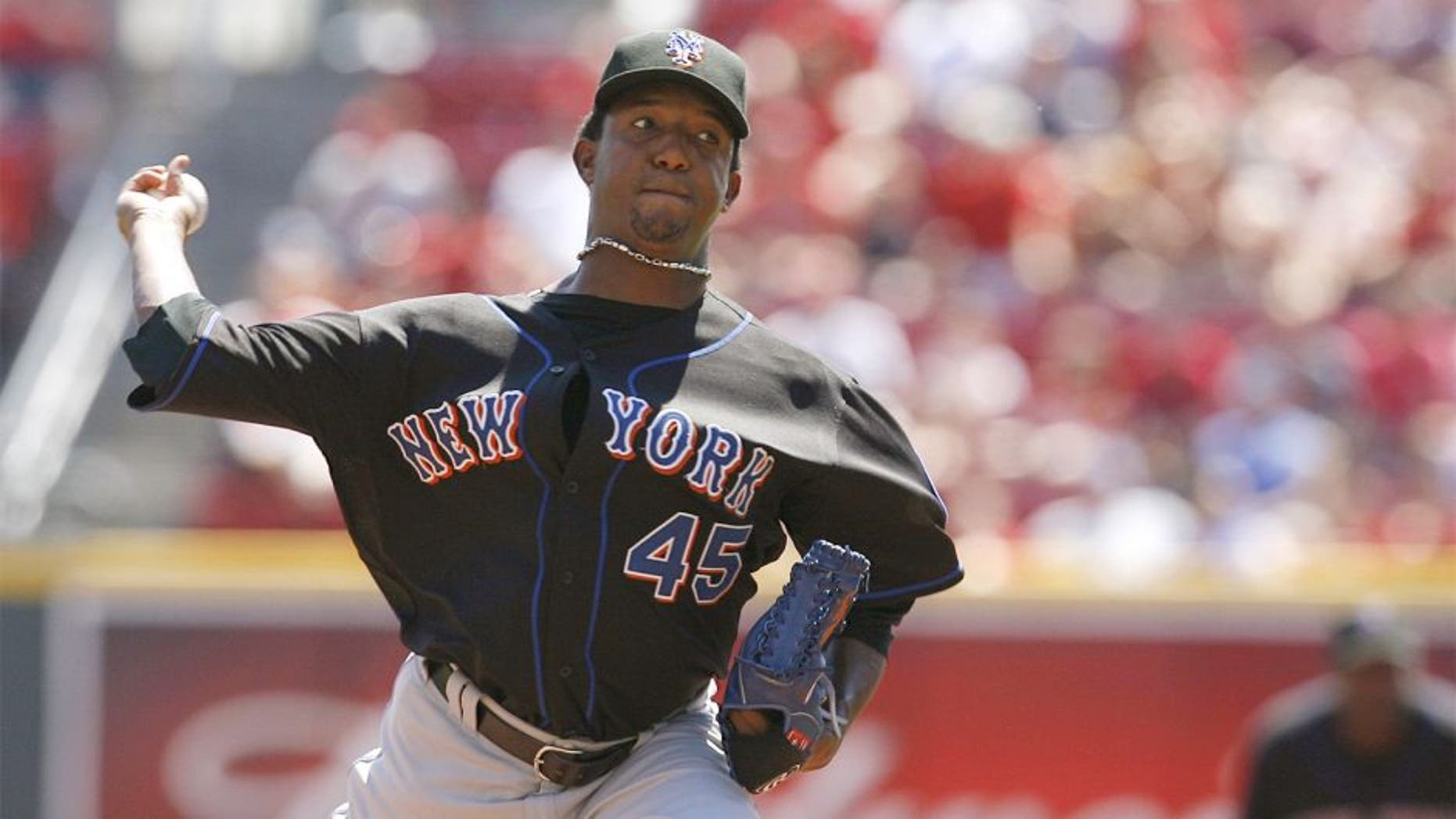 CINCINNATI - SEPTEMBER 3: Pitcher Pedro Martinez #45 of the New York Mets pitches against the Cincinnati Reds on September 3, 2007 at Great American Ball Park in Cincinnati, Ohio. Pedro Martinez recorded his 3000th strikeout during this game. (Photo by Thomas E. Witte/Getty Images)