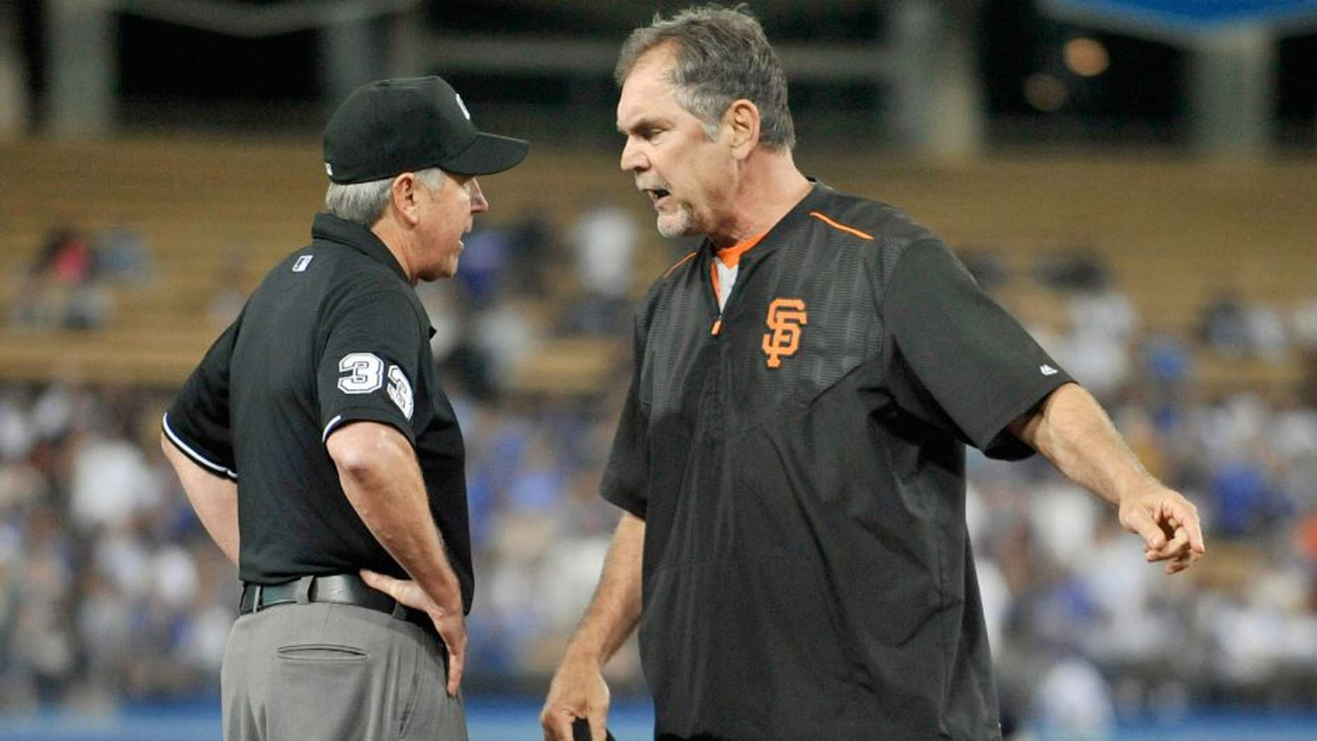 September 2, 2015; Los Angeles, CA, USA; San Francisco Giants manager Bruce Bochy (15) argues a call with umpire Mike Winters in the eighth inning at Dodger Stadium. Mandatory Credit: Gary A. Vasquez-USA TODAY Sports