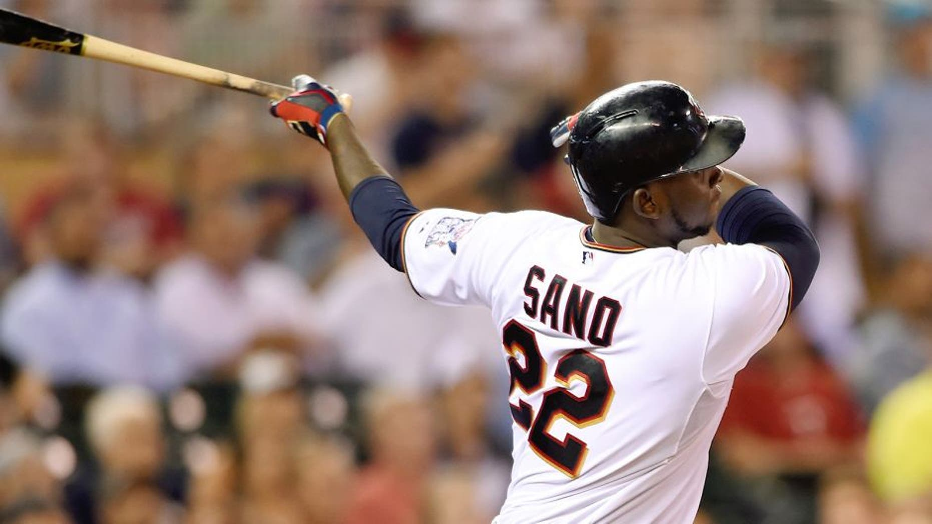 MINNEAPOLIS, MN - SEPTEMBER 1: Miguel Sano #22 of the Minnesota Twins hits a solo home run against the Chicago White Sox during the seventh inning of the game on September 1, 2015 at Target Field in Minneapolis, Minnesota. The Twins defeated the White Sox 8-6. (Photo by Hannah Foslien/Getty Images)