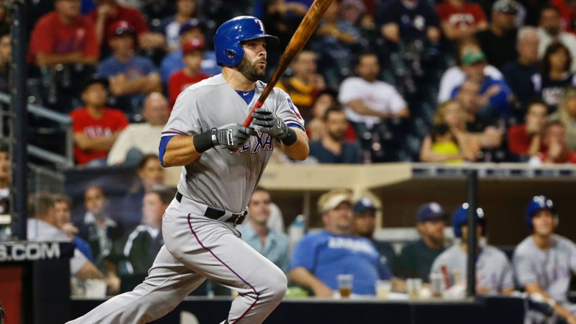 Texas Rangers' Mitch Moreland watches his run producing double just stay fair down the right field line in the tenth inning of a baseball game against the San Diego Padres Wednesday, Sept. 2, 2015, in San Diego. (AP Photo/Lenny Ignelzi)