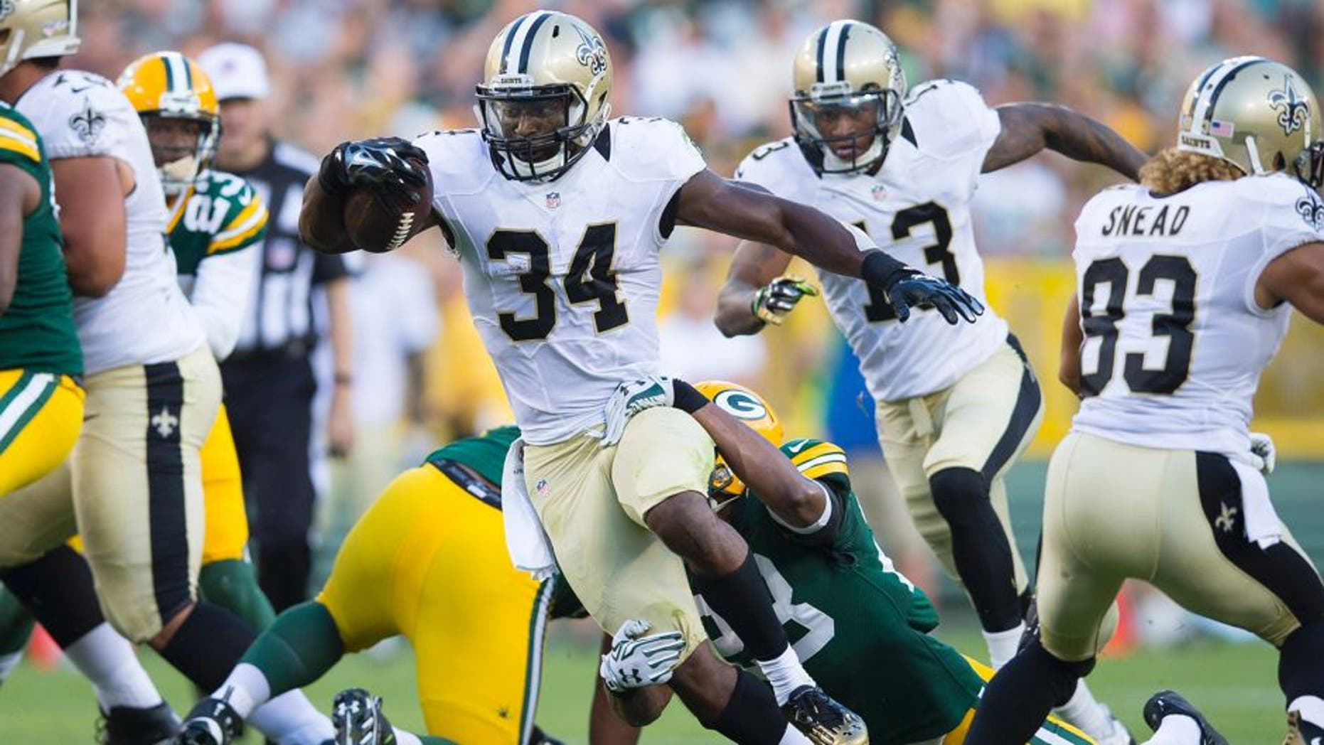 Sep 3, 2015; Green Bay, WI, USA; New Orleans Saints running back Tim Hightower (34) rushes with the football during the first quarter against the Green Bay Packers at Lambeau Field. Mandatory Credit: Jeff Hanisch-USA TODAY Sports