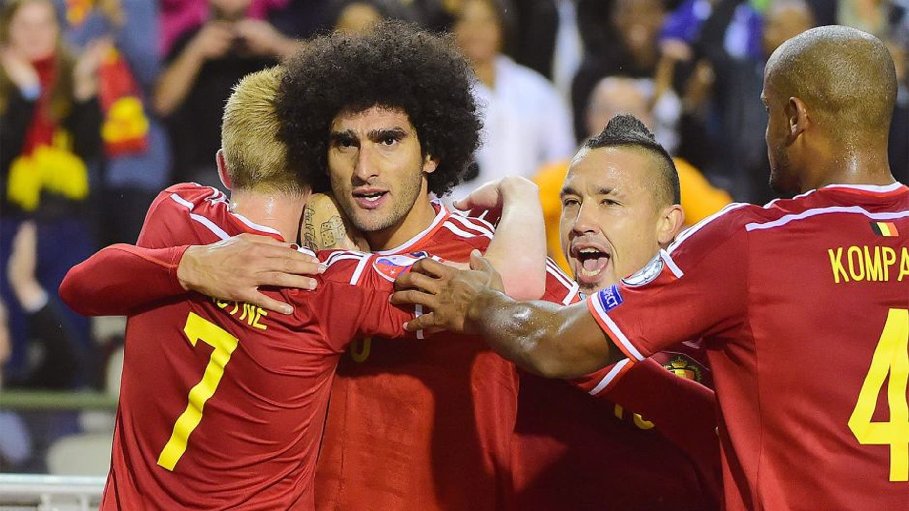 Belgium's Marouane Fellaini (2ndL) celebrates after scoring during the Euro 2016 qualifying match between Belgium and Bosnia and Herzegovina at the King Baudouin Stadium in Brussels, on September 3, 2015. AFP PHOTO / EMMANUEL DUNAND (Photo credit should read EMMANUEL DUNAND/AFP/Getty Images)