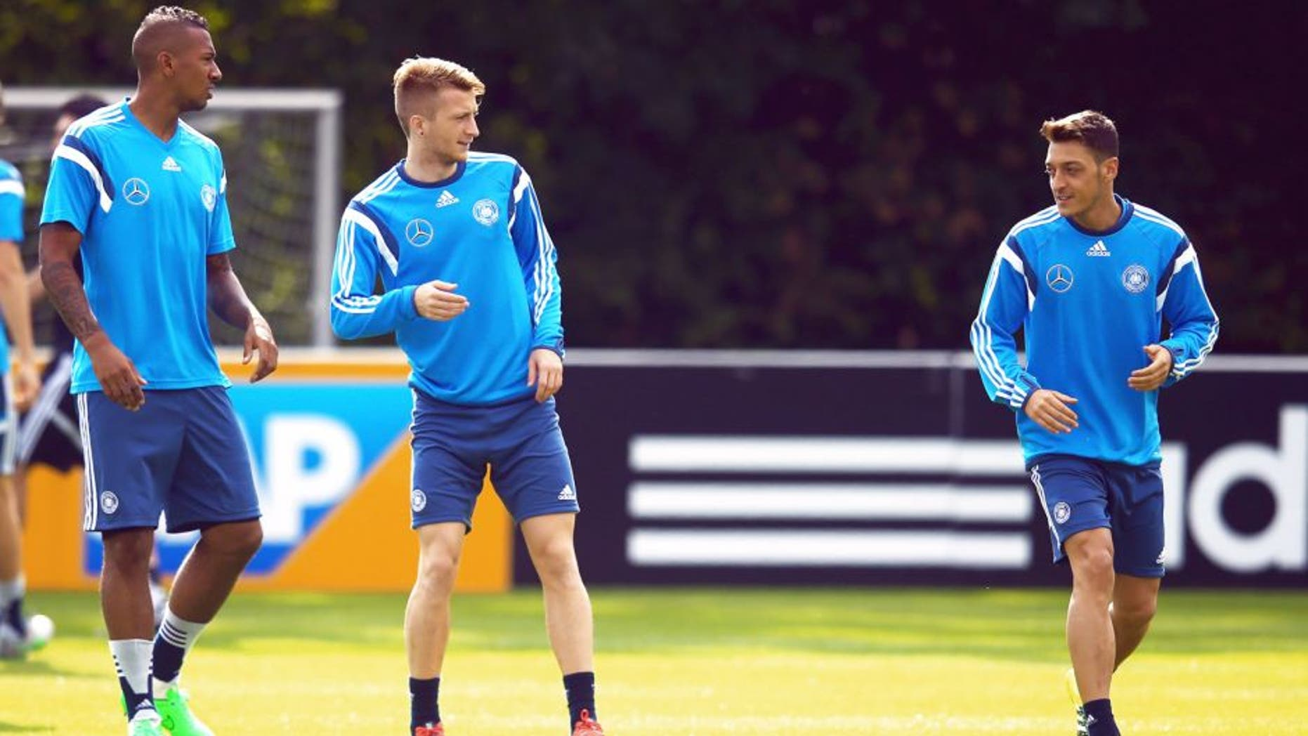 FRANKFURT AM MAIN, GERMANY - SEPTEMBER 02: Jerome Boateng, Marco Reus and Mesut Oezil (L-R) attend a Germany training session at 'Kleine Kampfbahn' training ground on September 2, 2015 in Frankfurt am Main, Germany. (Photo by Alex Grimm/Bongarts/Getty Images)