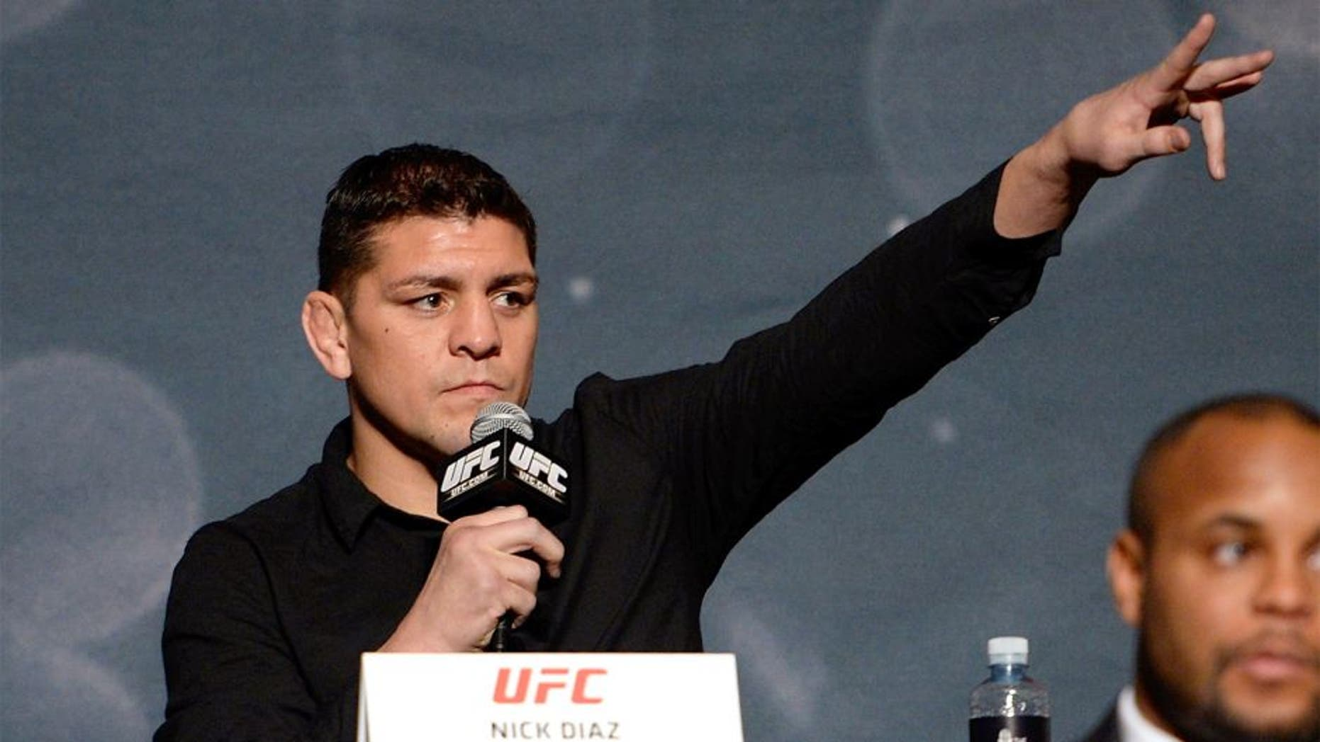 LAS VEGAS, NEVADA - NOVEMBER 17: UFC middleweight Nick Diaz interacts with the crowd during the UFC Time Is Now press conference at The Smith Center for the Performing Arts on November 17, 2014 in Las Vegas, Nevada. (Photo by Jeff Bottari/Zuffa LLC/Zuffa LLC via Getty Images)