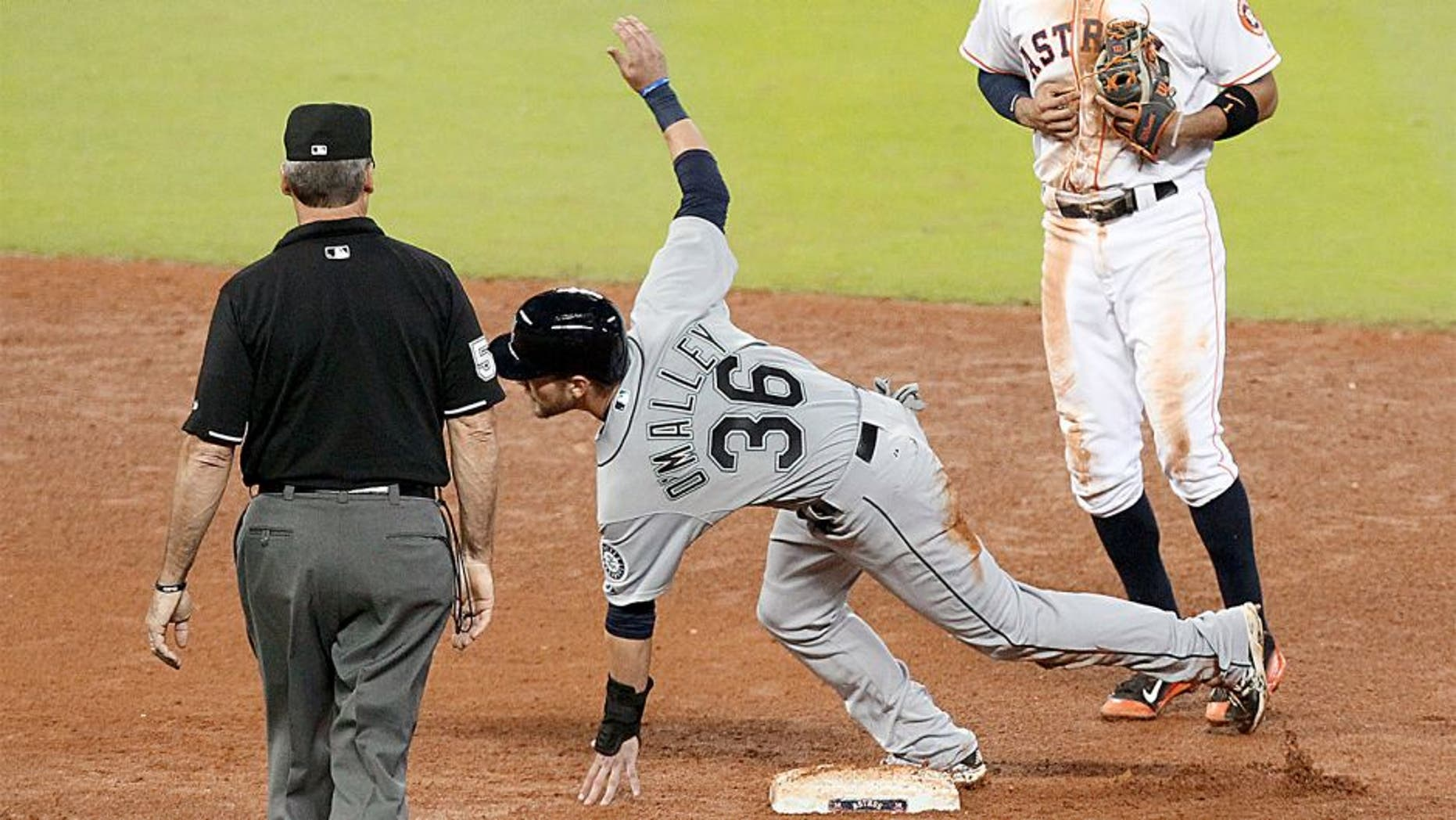 Sep 2, 2015; Houston, TX, USA; Seattle Mariners center fielder Shawn O'Malley (36) steals second base against Houston Astros shortstop Carlos Correa (1) in the top of the seventh inning at Minute Maid Park. Seattle Mariners won 8 to 3. Mandatory Credit: Thomas B. Shea-USA TODAY Sports