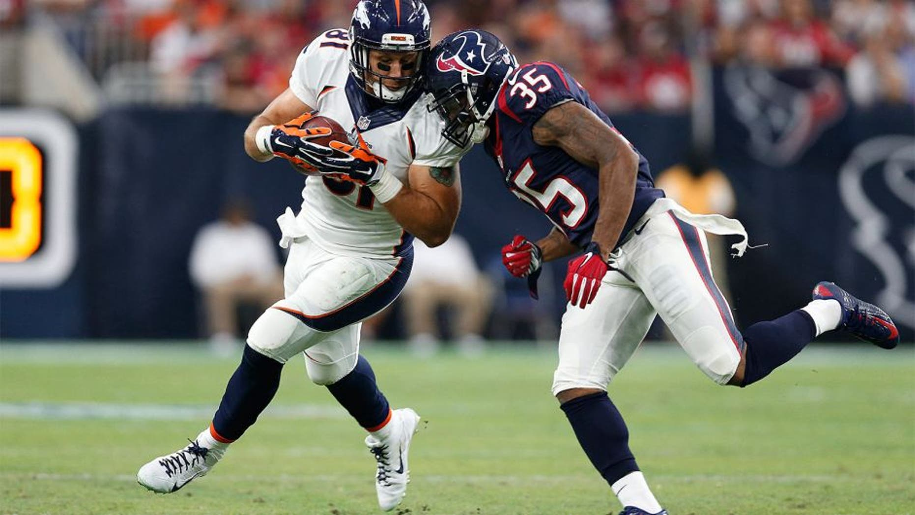 Aug 22, 2015; Houston, TX, USA; Denver Broncos tight end Owen Daniels (81) is tackled after a reception by Houston Texans safety Eddie Pleasant (35) at NRG Stadium. Mandatory Credit: Matthew Emmons-USA TODAY Sports