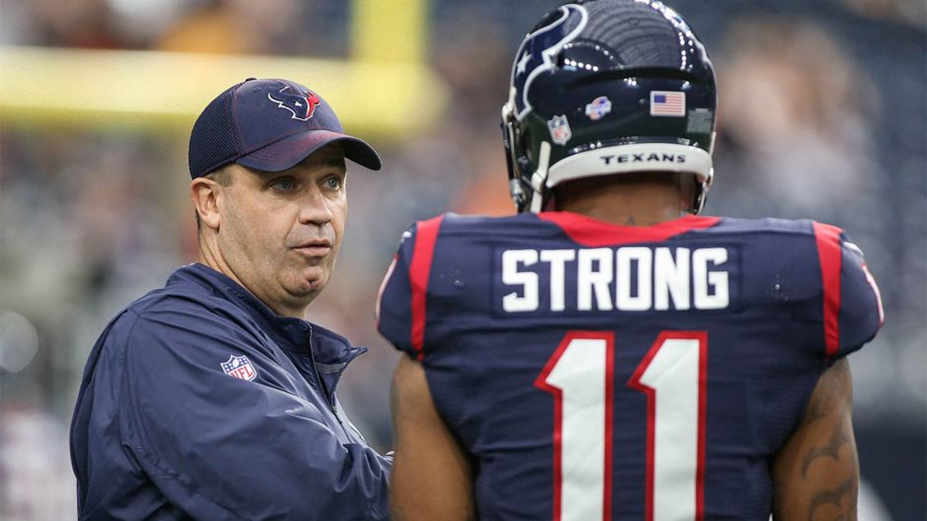 Aug 22, 2015; Houston, TX, USA; Houston Texans head coach Bill O'Brien talks with wide receiver Jaelen Strong (11) before a game against the Denver Broncos at NRG Stadium. Mandatory Credit: Troy Taormina-USA TODAY Sports