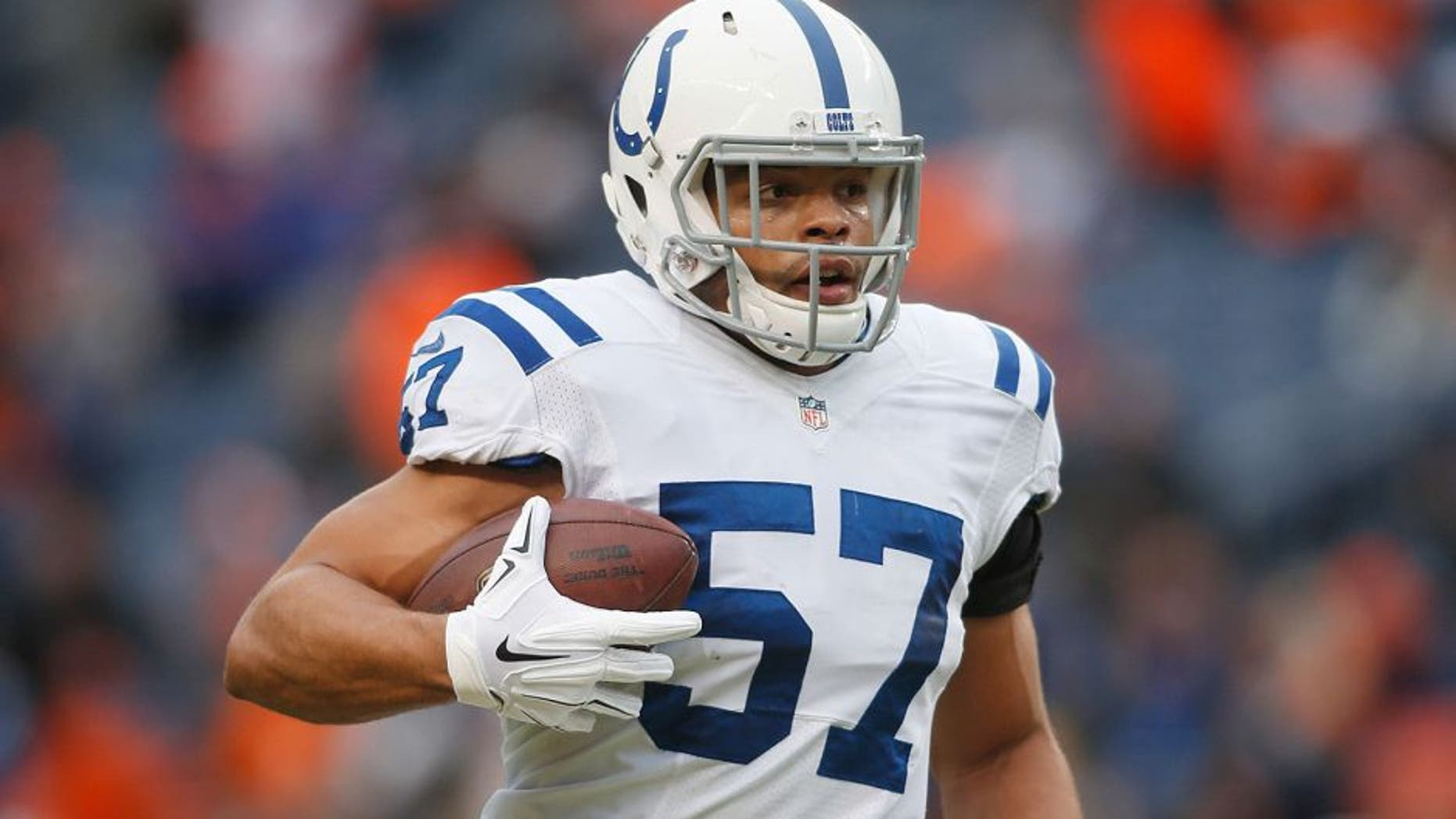 Jan 11, 2015; Denver, CO, USA; Indianapolis Colts outside linebacker Josh McNary (57) in the 2014 AFC Divisional playoff football game against the Denver Broncos at Sports Authority Field at Mile High. Mandatory Credit: Chris Humphreys-USA TODAY Sports