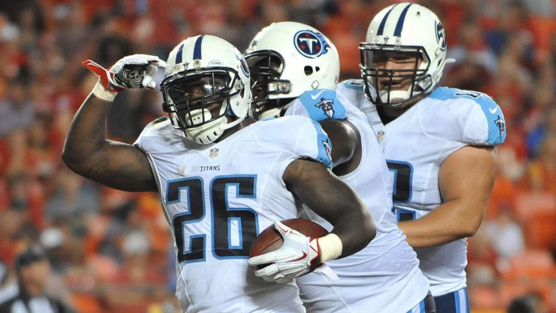 Aug 28, 2015; Kansas City, MO, USA; Tennessee Titans running back Antonio Andrews (26) celebrates after scoring a touchdown against the Kansas City Chiefs during the first half at Arrowhead Stadium. Mandatory Credit: Denny Medley-USA TODAY Sports