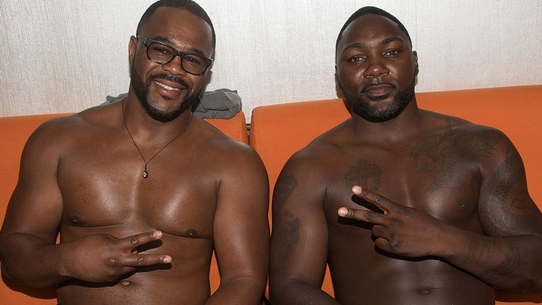 LAS VEGAS, NV - JULY 09: (L-R) Rashad Evans and Anthony Johnson pose for a photo during a UFC pool party as part of the International Fight Week events at the Liquid Pool Lounge at the Aria Resort & Casino at CityCenter on July 9, 2015 in Las Vegas, Nevada. (Photo by Al Powers/Zuffa LLC/Zuffa LLC via Getty Images)