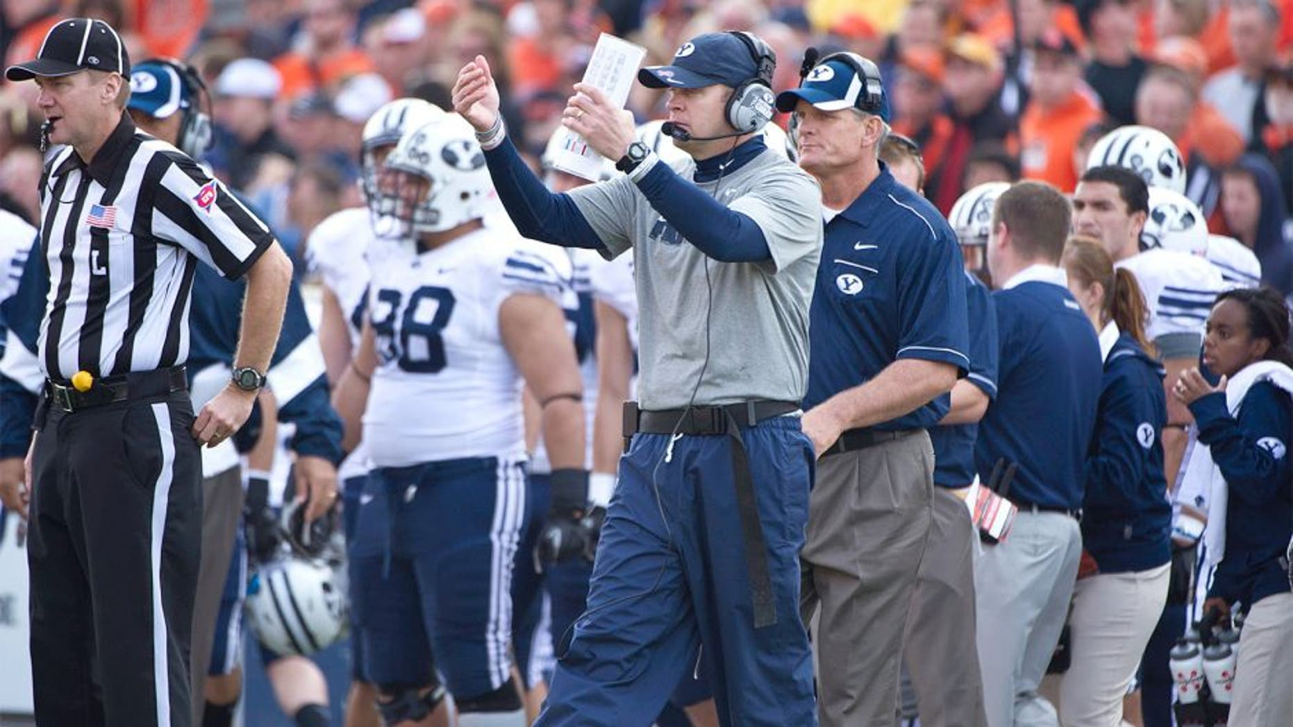 Oct 15, 2011; Corvallis, OR, USA; Brigham Young Cougars head coach Bronco Mendenhall calls his team over during the second half against the Oregon State Beavers at Reser Stadium. Mandatory Credit: Jim Z. Rider-USA TODAY Sports.