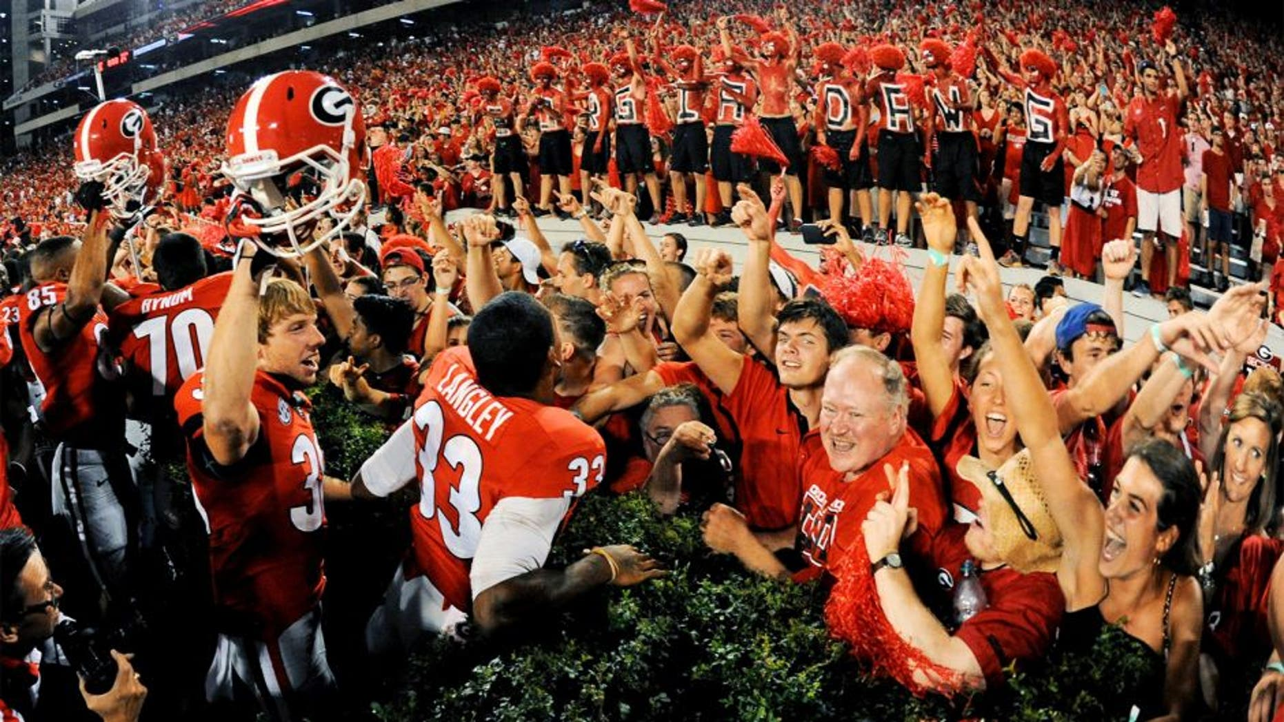 Aug 30, 2014; Athens, GA, USA; Georgia Bulldogs players and fans react after defeating the Clemson Tigers at Sanford Stadium. Georgia defeated Clemson 45-21. Mandatory Credit: Dale Zanine-USA TODAY Sports