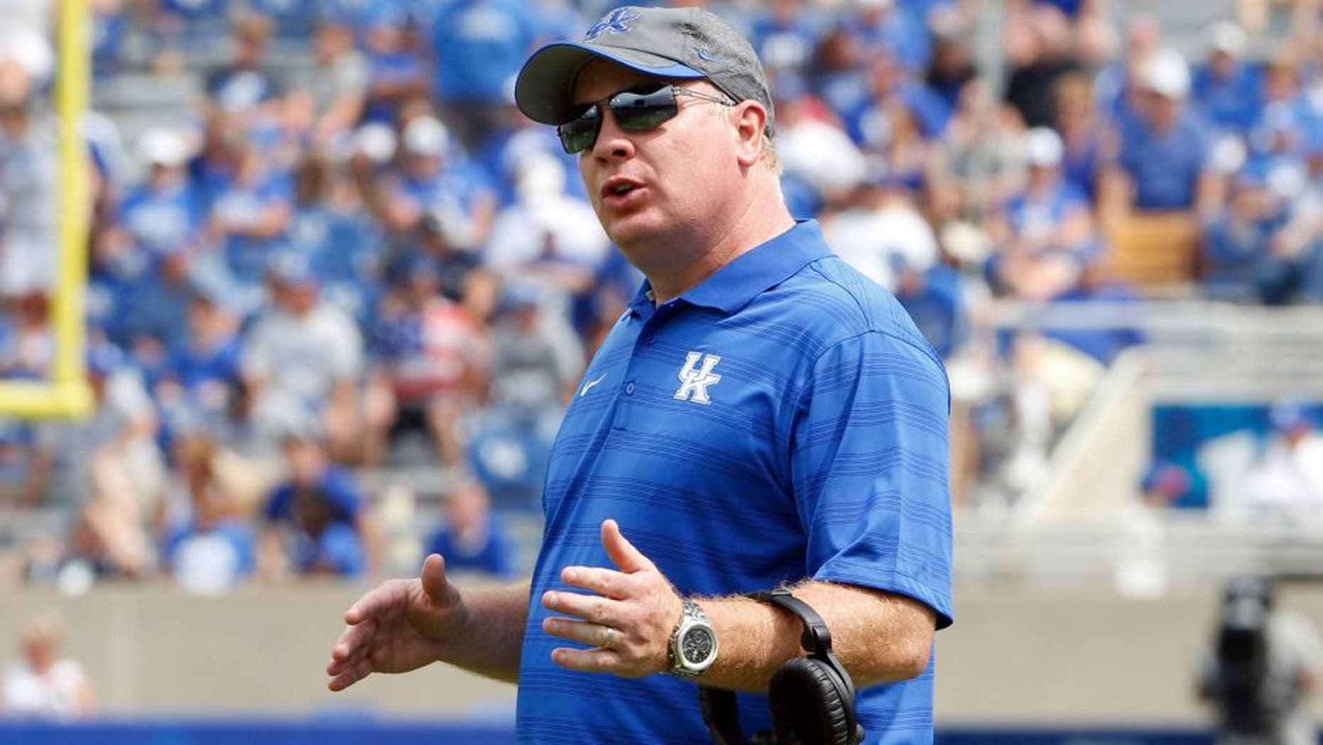 Aug 30, 2014; Lexington, KY, USA; Kentucky Wildcats head coach Mark Stoops reacts during the game against the UT Martin Skyhawks in the second half at Commonwealth Stadium. Kentucky defeated UT Martin 59-14. Mandatory Credit: Mark Zerof-USA TODAY Sports