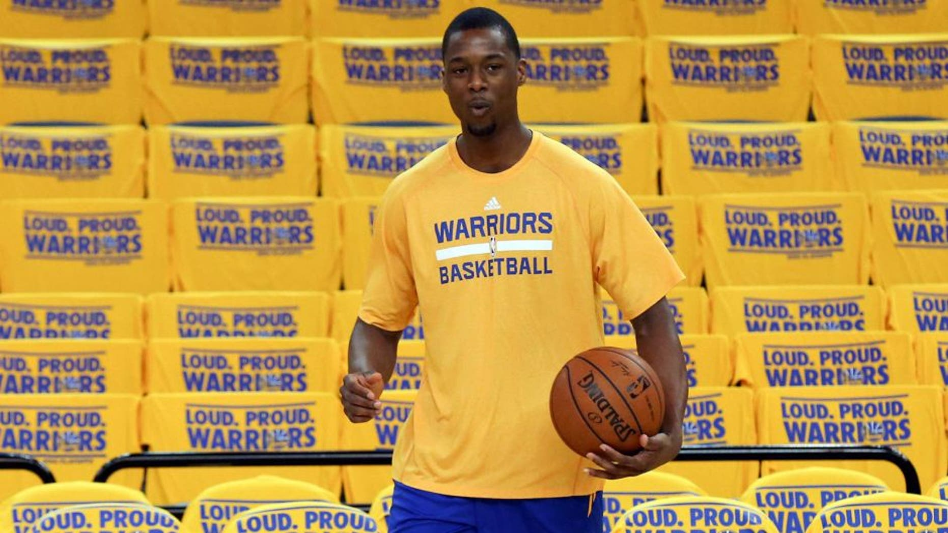 Apr 24, 2014; Oakland, CA, USA; Golden State Warriors forward Harrison Barnes (40) warms up before game three of the first round of the 2014 NBA Playoffs against the Los Angeles Clippers at Oracle Arena. Mandatory Credit: Kelley L Cox-USA TODAY Sports