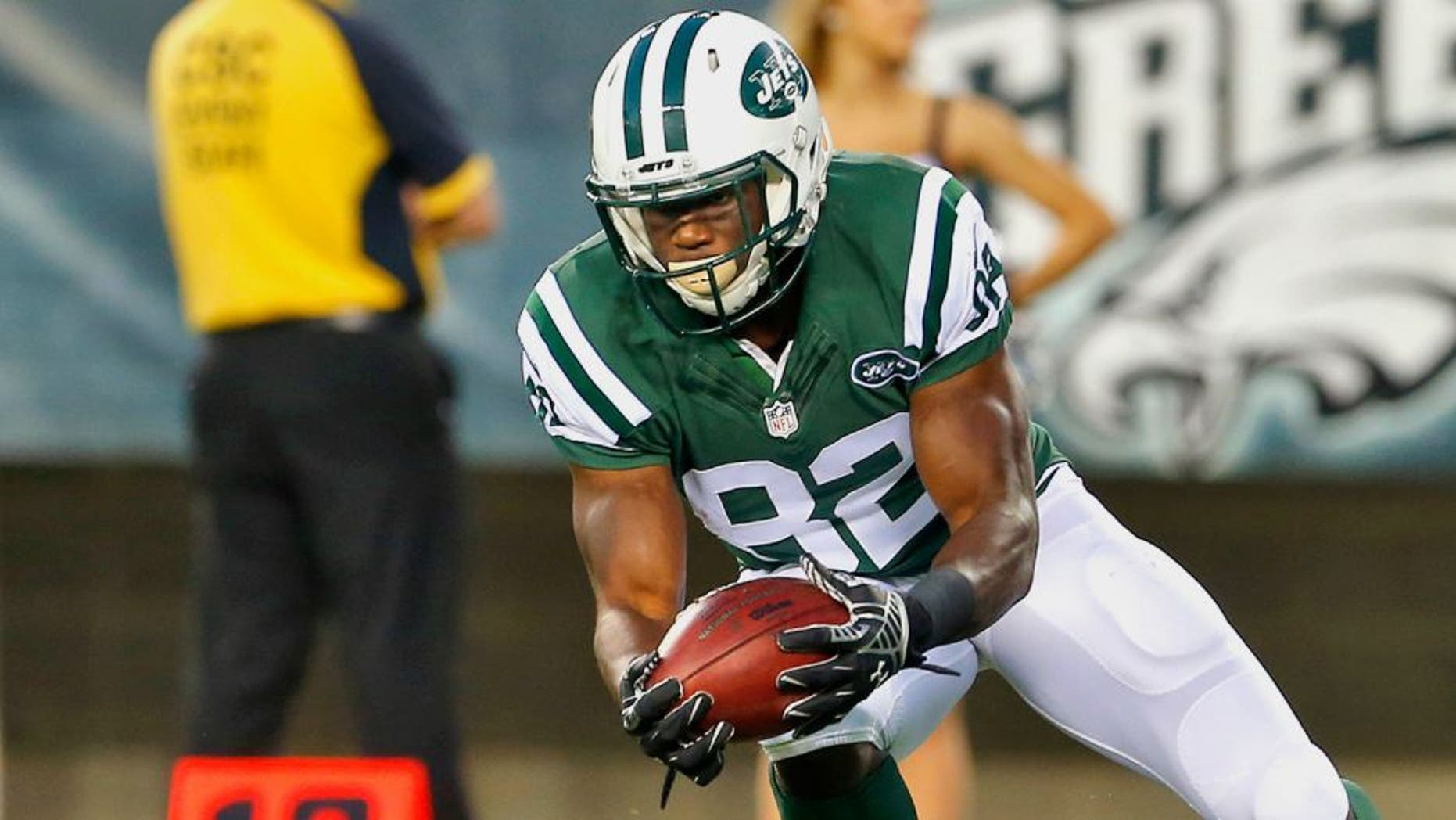 PHILADELPHIA, PA - AUGUST 28: Quincy Enunwa #82 of the New York Jets downs the ball on a punt on the sis years line during a preseason football game against the Philadelphia Eagles at Lincoln Financial Field on August 28, 2014 in Philadelphia, Pennsylvania. (Photo by Rich Schultz /Getty Images)