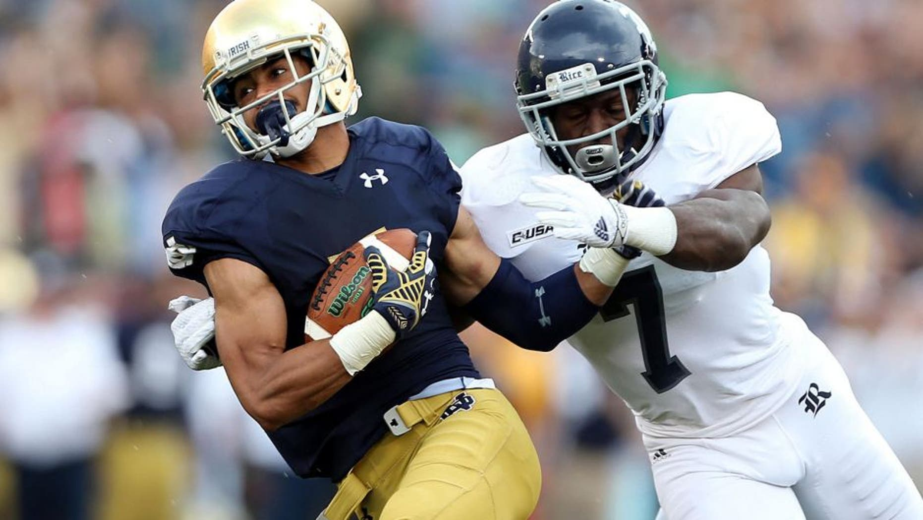 Aug 30, 2014; South Bend, IN, USA; Notre Dame Fighting Irish wide receiver Will Fuller (7) catches a pass for a 75 yard touchdown against Rice Owls safety Julius White (7) at Notre Dame Stadium. Mandatory Credit: Brian Spurlock-USA TODAY Sports