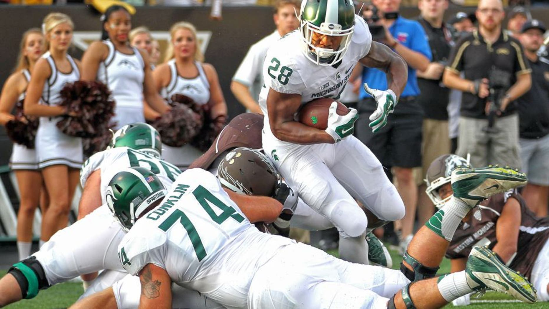 Sep 4, 2015; Kalamazoo, MI, USA; Michigan State Spartans running back Madre London (28) runs the ball against the Western Michigan Broncos prior to a game at Waldo Stadium. Mandatory Credit: Mike Carter-USA TODAY Sports