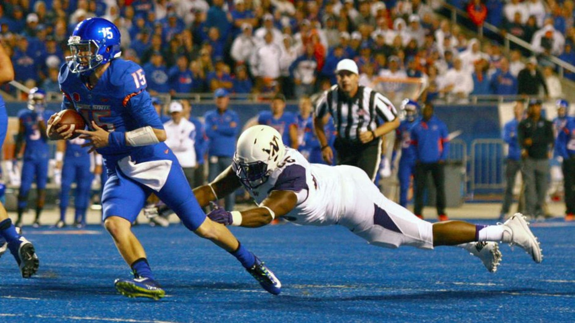 Sep 4, 2015; Boise, ID, USA; Boise State Broncos quarterback Ryan Finley (15) runs away from Washington Huskies defensive lineman Damion Turpin (66) during the first half at Albertsons Stadium. Mandatory Credit: Brian Losness-USA TODAY Sports